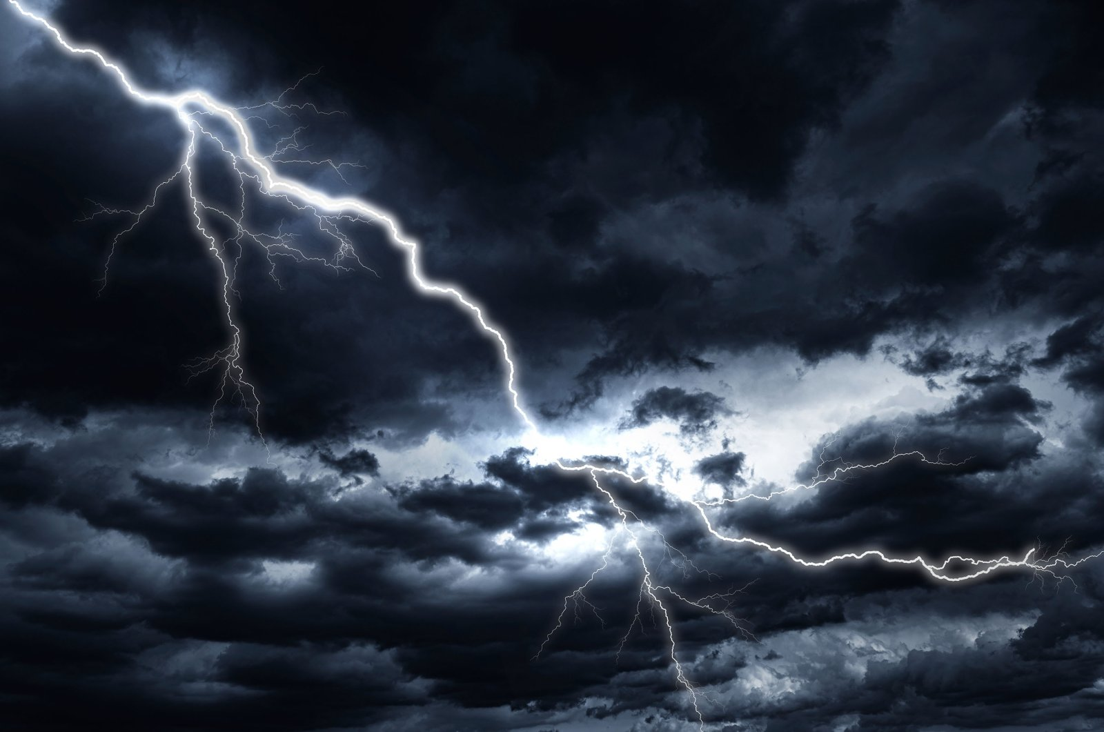 Lightning strike against the background of a cloudy dark sky. (Shutterstock Photo)