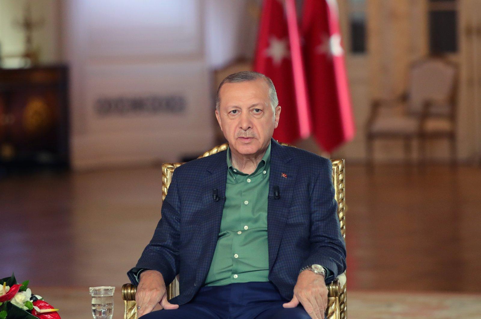President Recep Tayyip Erdoğan listens during a televised broadcast on ATV/A Haber news channels at Ankara's Çankaya Mansion, Turkey, Aug. 4, 2021 (AA Photo)