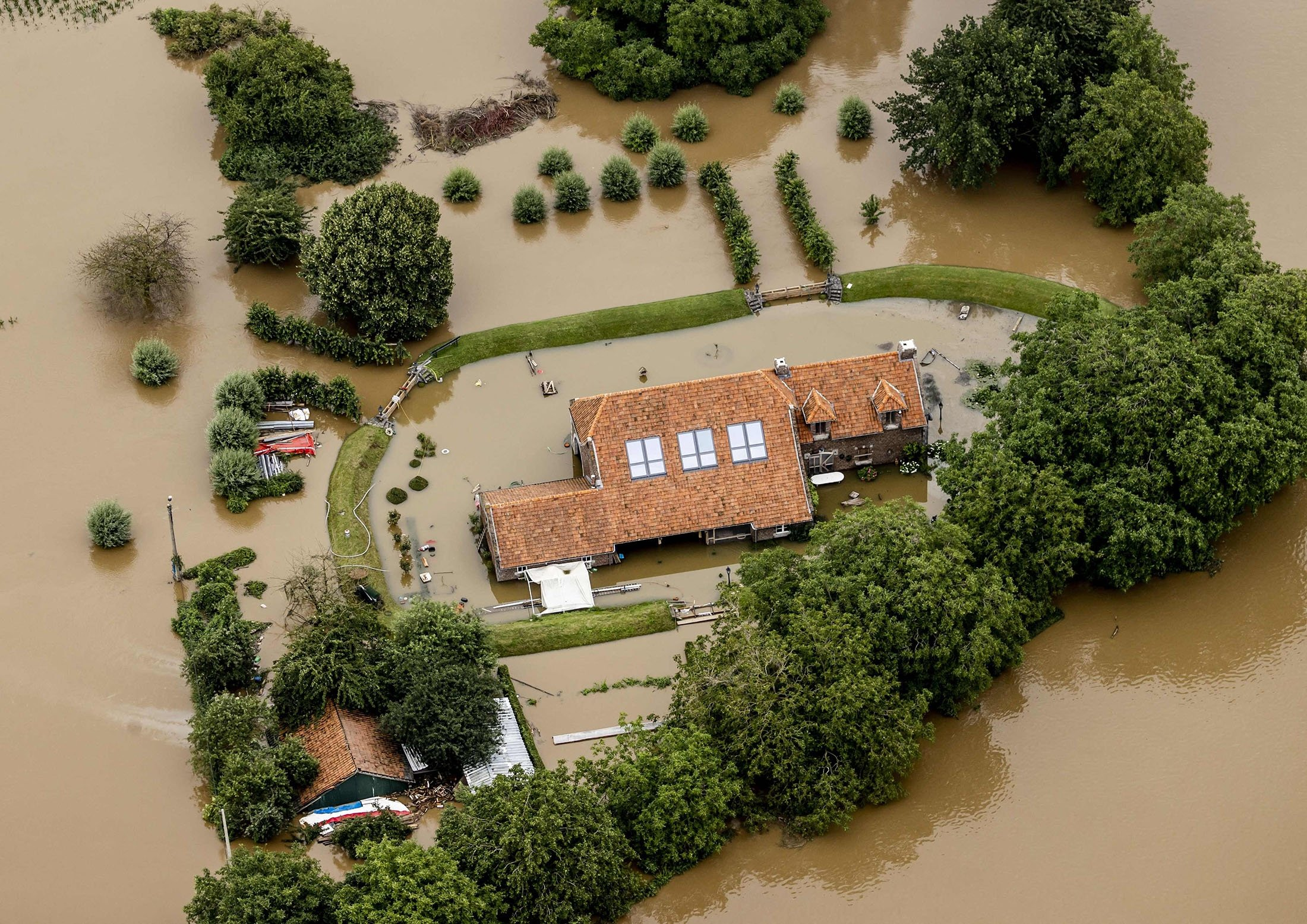 Aerial view of Valkenburg showing the flooded area around the Meuse, Limburg, the Netherlands, July 16, 2021. (AFP Photo)