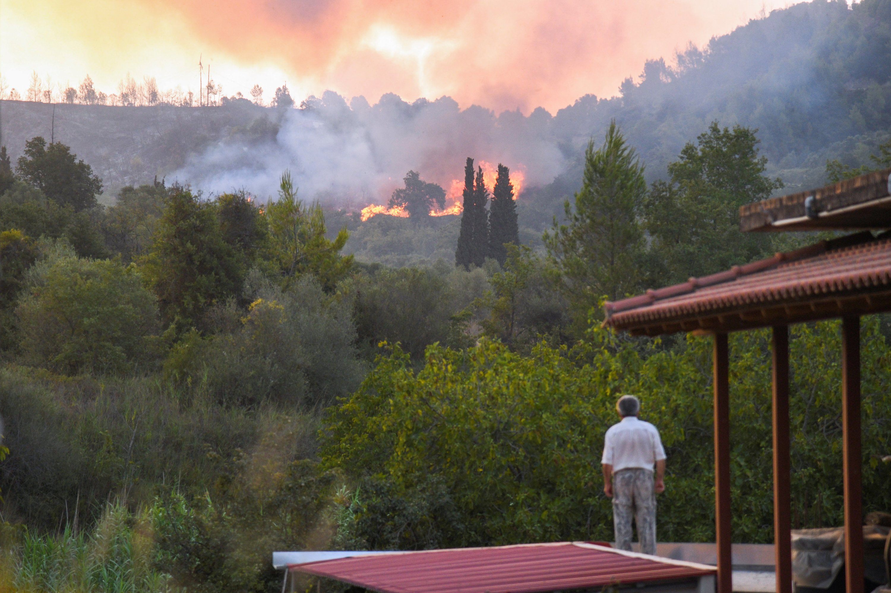 Flames rise as a wildfire burns near the site of ancient Olympia, Greece, August 5, 2021. (Reuters Photo)