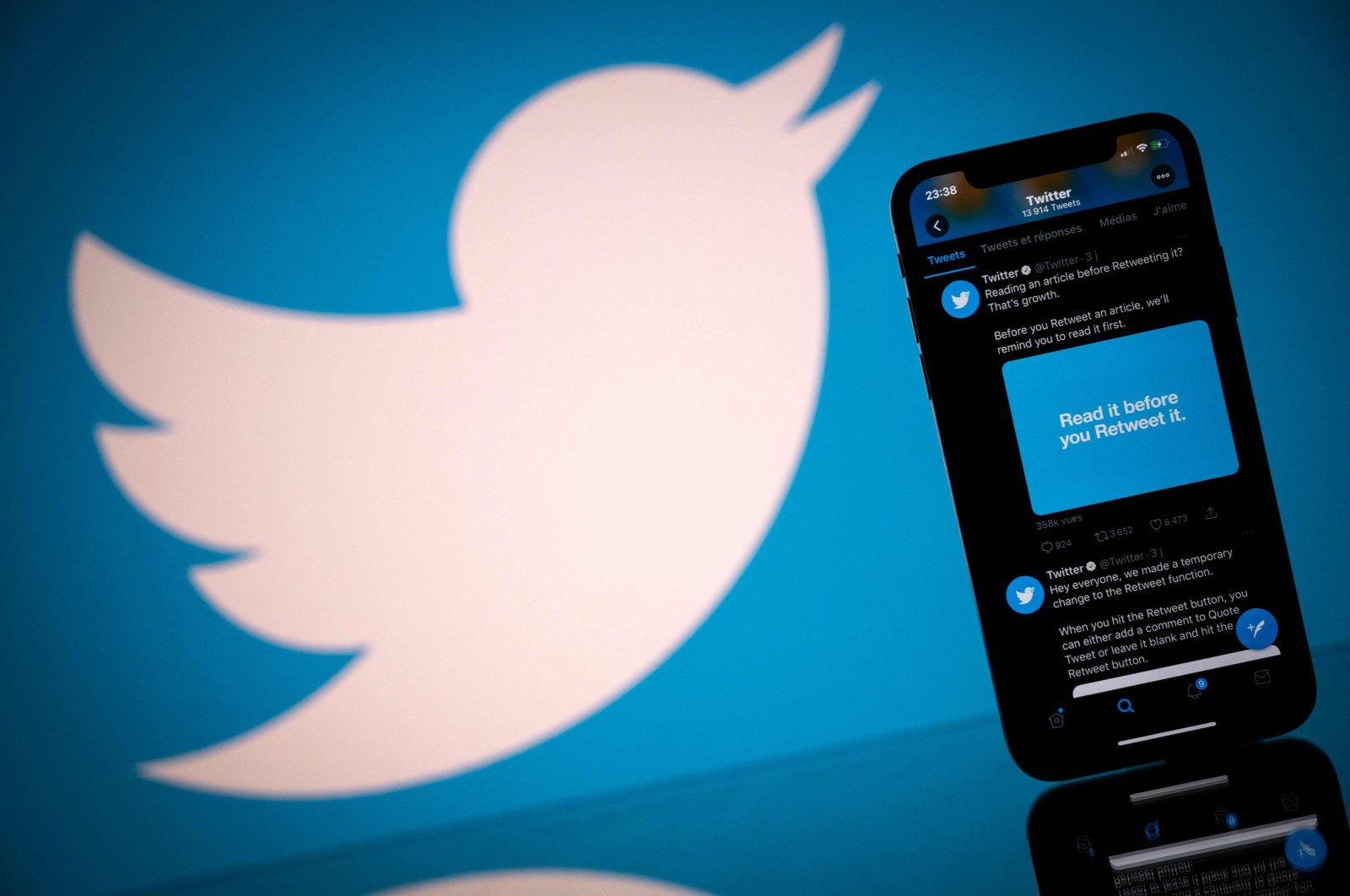 The logo of U.S. social network Twitter is displayed on the screen of a smartphone and a tablet in Toulouse, southern France, Oct. 26, 2020. (AFP Photo)