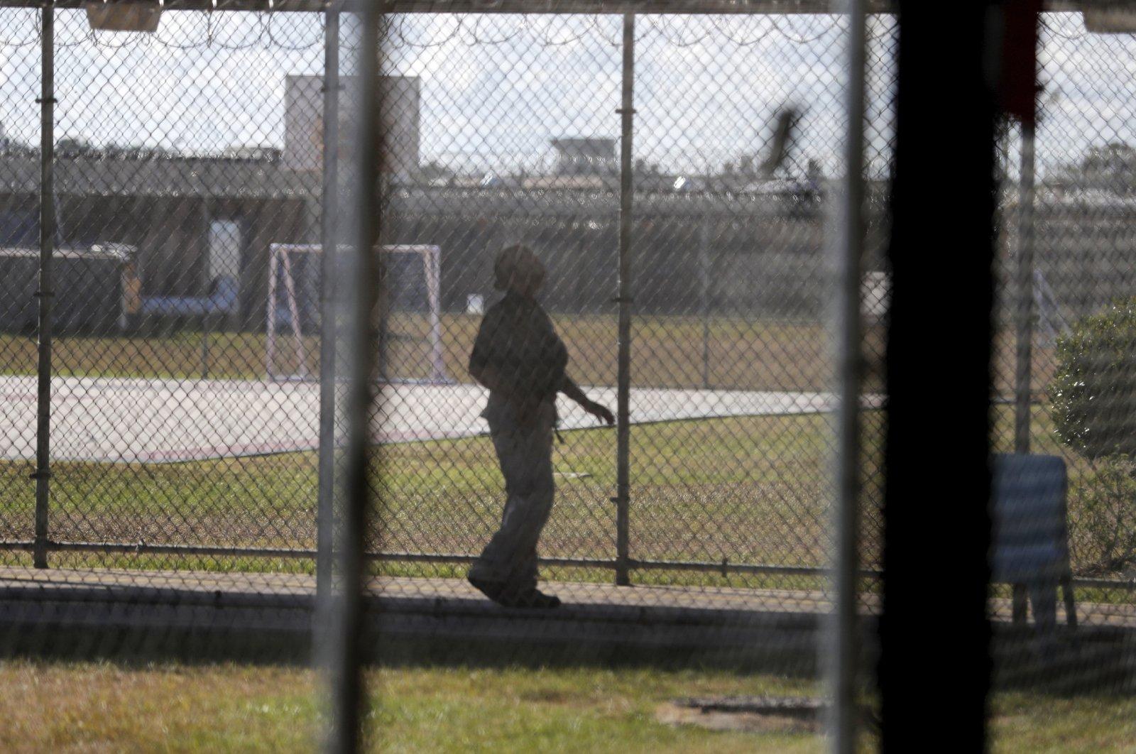 A guard walks on a path between yards during a media tour inside the Winn Correctional Center, in Winnfield, Louisiana, U.S., Sept. 26, 2019. (AP Photo)