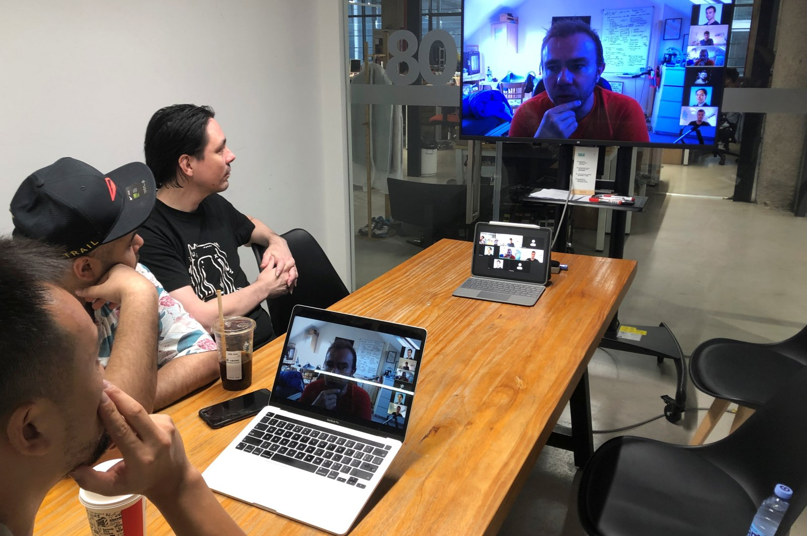 Hax's engineers discuss a prototype with the team from Unicorn Bio over a video call amid the global coronavirus pandemic, from their office at Huaqiangbei electronics market in Shenzhen, Guangdong province, China, July 16, 2021. (Reuters Photo)