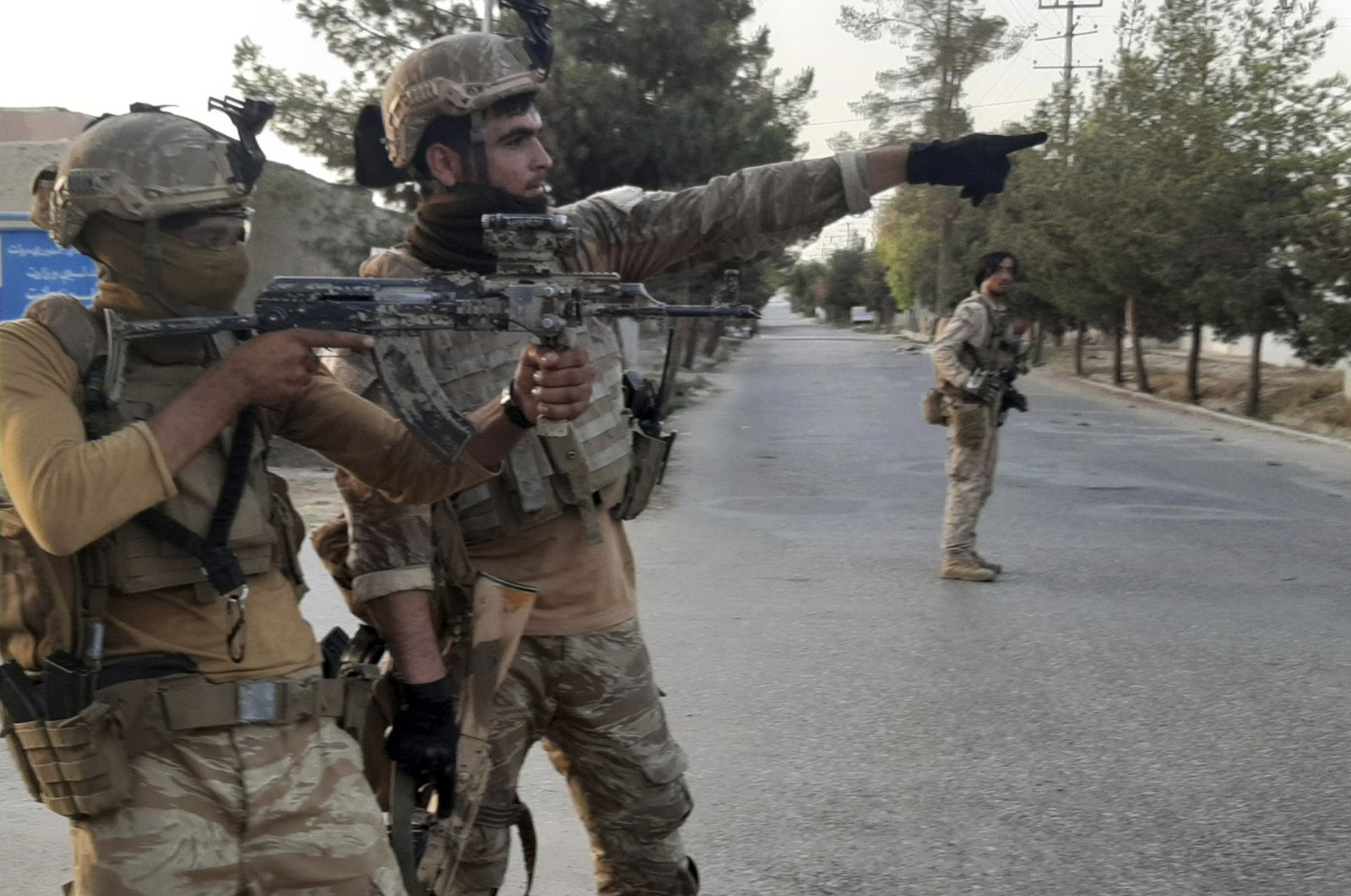 Afghan Special forces patrol a deserted street during fighting with Taliban fighters, in Lashkar Gah, Helmand province, southern Afghanistan, Aug. 3, 2021. (AP Photo)