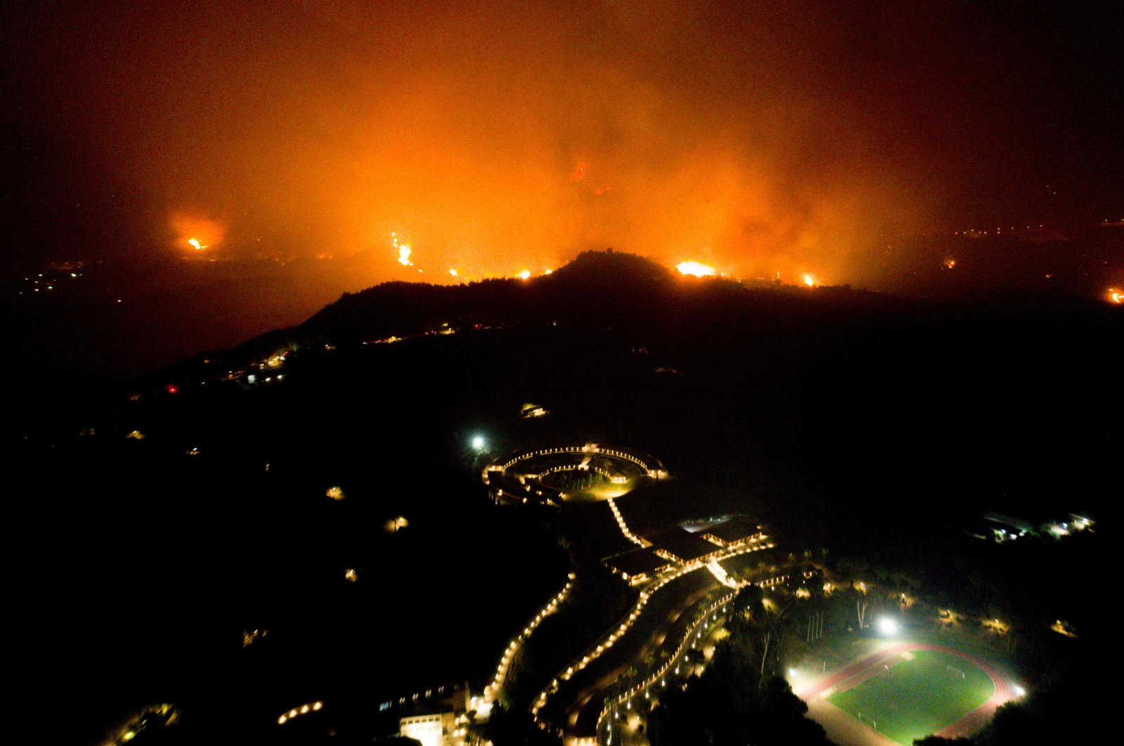 A wildfire approaches the Olympic Academy in ancient Olympia in western Greece on Aug. 4, 2021. (AFP Photo)