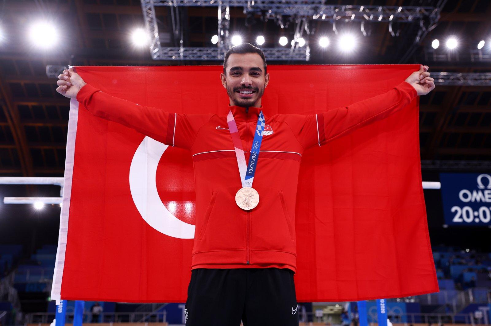 Turkey's Ferhat Arıcan celebrates winning bronze in the Tokyo 2020 Olympics men's parallel bars event at the Ariake Gymnastics Centre, Tokyo, Japan, Aug. 3, 2021. (Reuters Photo)