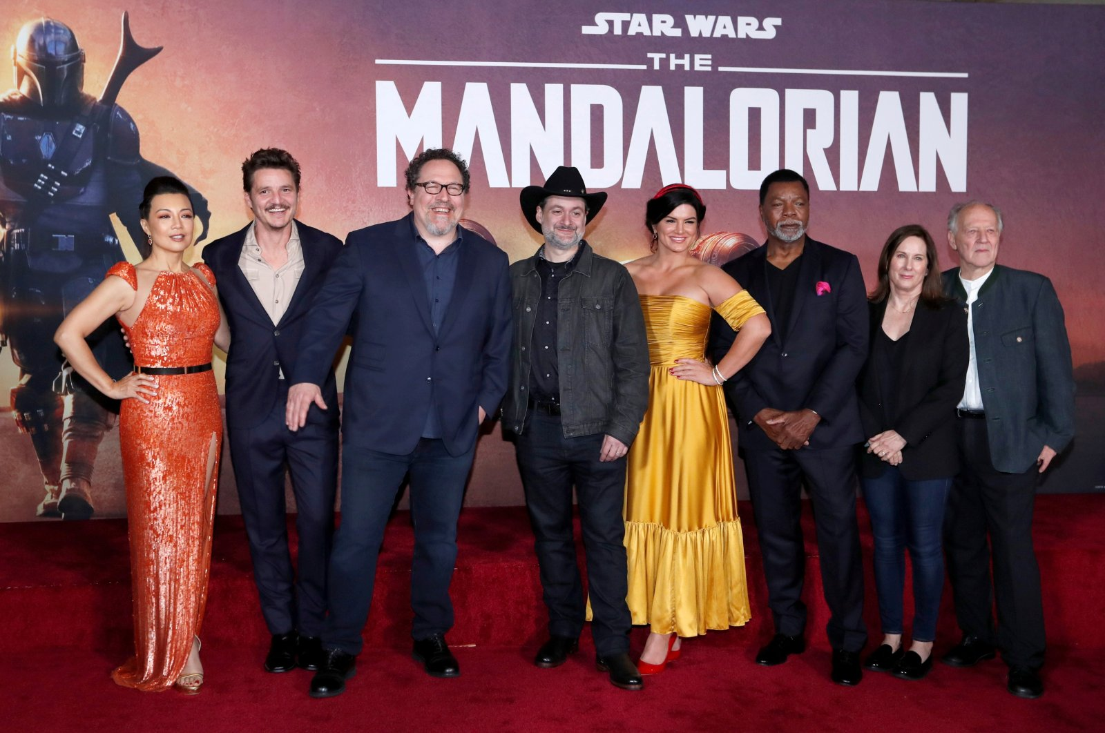 """Creator Jon Favreau (3rd L), President of Lucasfilm Kathleen Kennedy (2nd R), executive producer Dave Filoni (C) pose with cast members (L-R) Ming-Na Wen, Pedro Pascal, Gina Carano, Carl Weathers and Werner Herzog at the premiere for the television series """"The Mandalorian"""" in Los Angeles, California, U.S., Nov. 13, 2019. (Reuters Photo)"""