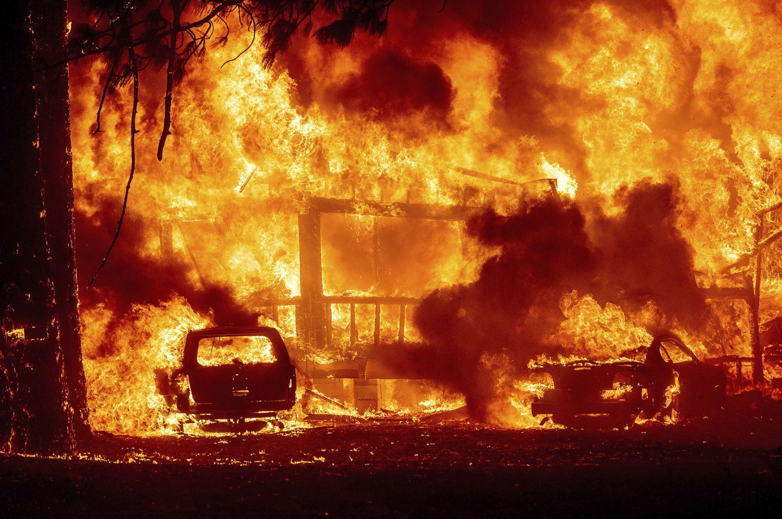 Flames consume a home on Highway 89 as the Dixie Fire tears through the Greenville community of Plumas County, California, U.S., Aug. 4, 2021. (AP Photo)