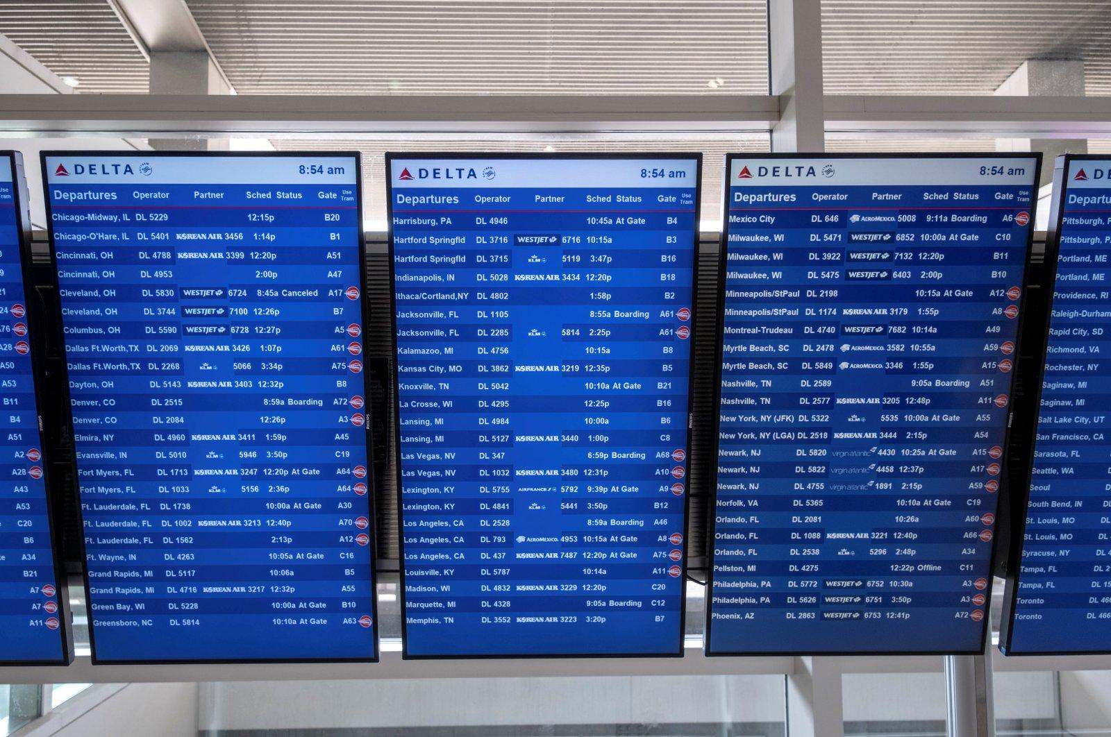Flight information display screens are seen at the Detroit Metropolitan Wayne County Airport in Detroit, Michigan, U.S. June 12, 2021. (Reuters Photo)