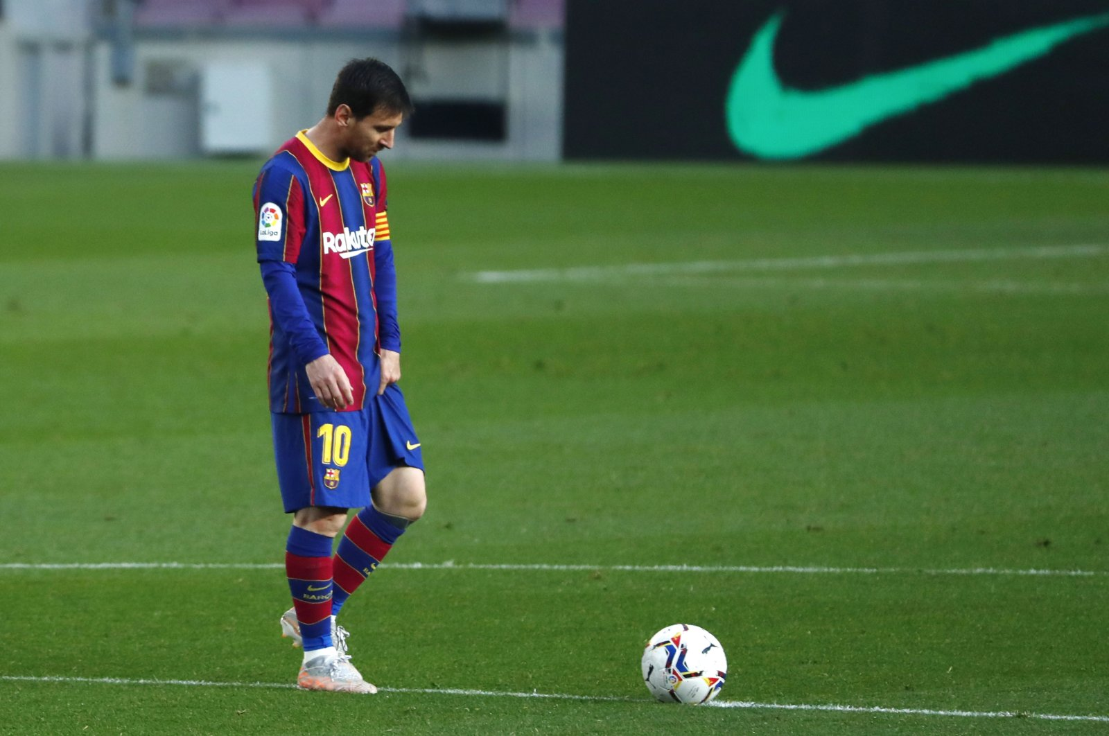 Barcelona's Lionel Messi reacts during the Spanish La Liga match against Granada at the Camp Nou stadium in Barcelona, Spain, April 29, 2021. (AP Photo)