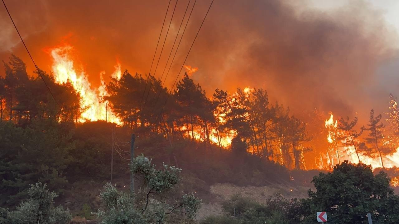 Flames engulf a forest in Muğla, southwestern Turkey, Aug. 6, 2021. (İHA Photo)