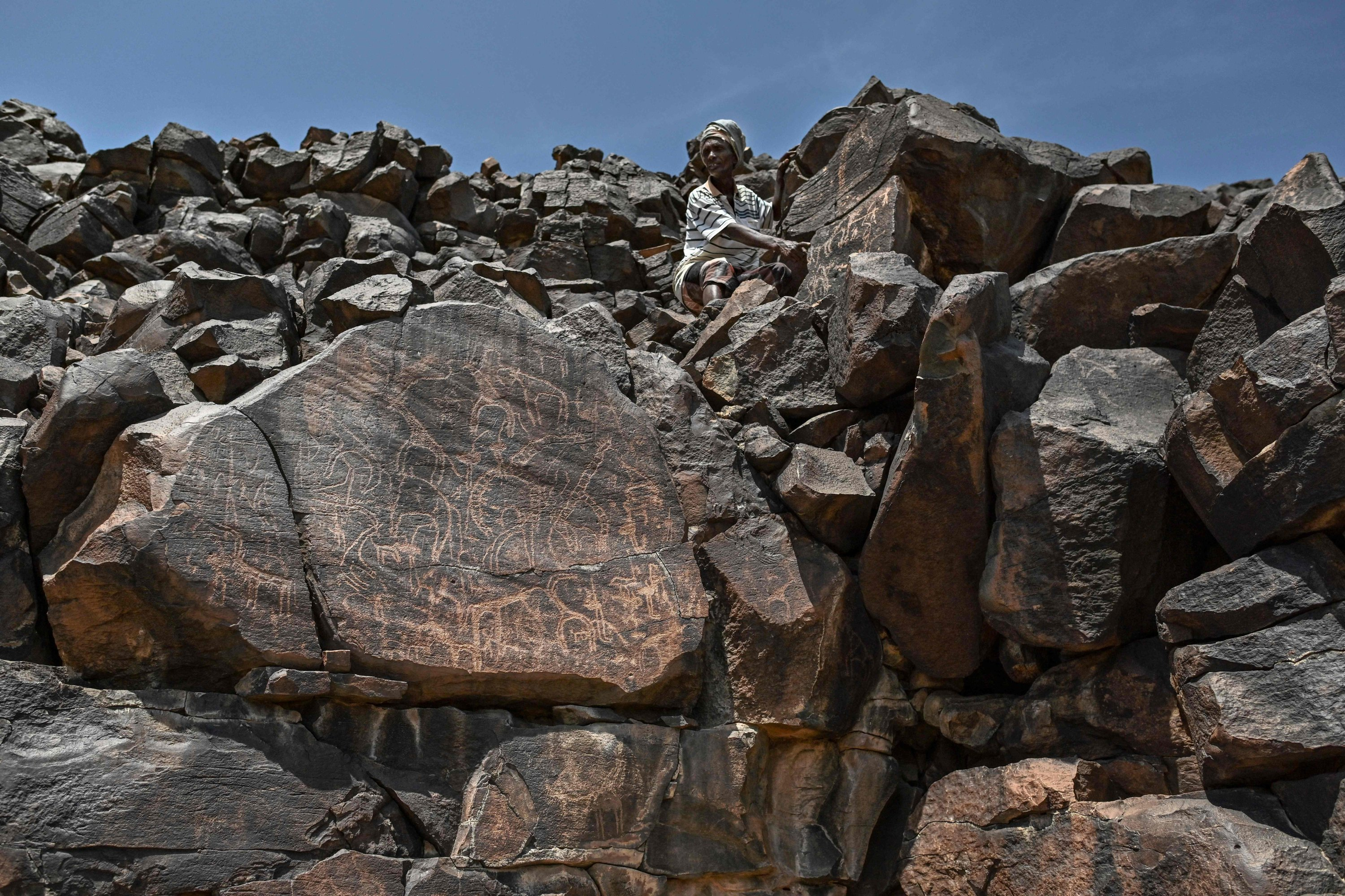 Ibrahim Dabale, 50, an art guardian and native of Djibouti, narrates on ancient depictions at the remote Abourma Rock Art site in the Makarassou Massif of Tadjoura Region, nothern Djibouti, April 13, 2021. (AFP Photo)