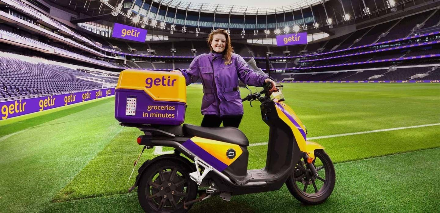 A Getir courier is seen at the Tottenham Hotspur Stadium in London, U.K., in this undated file photo. (Courtesy of Getir)