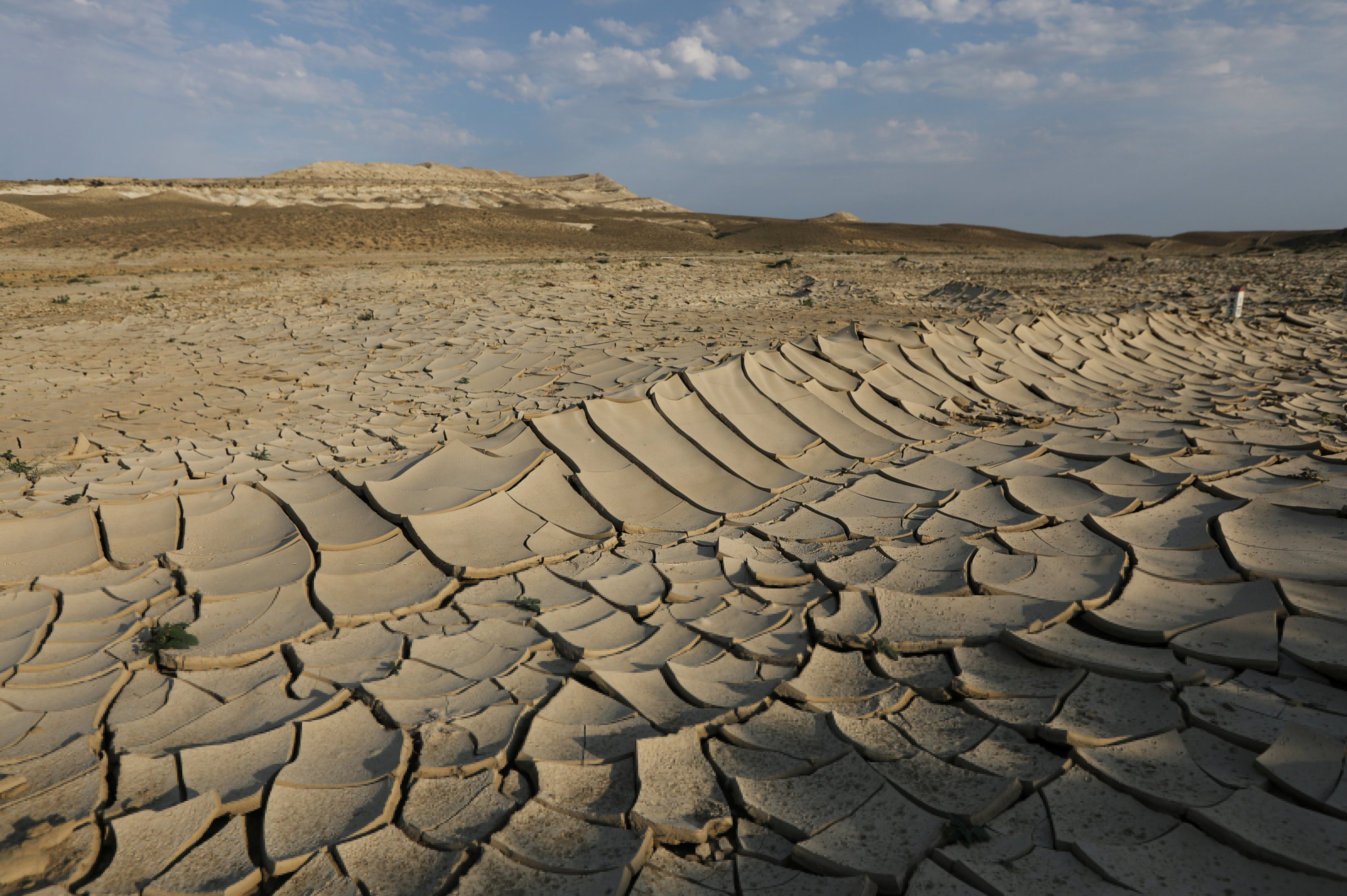 Cracked ground is pictured amid severe drought in Mangistau Region, Kazakhstan, on July 27, 2021. (Reuters Photo)