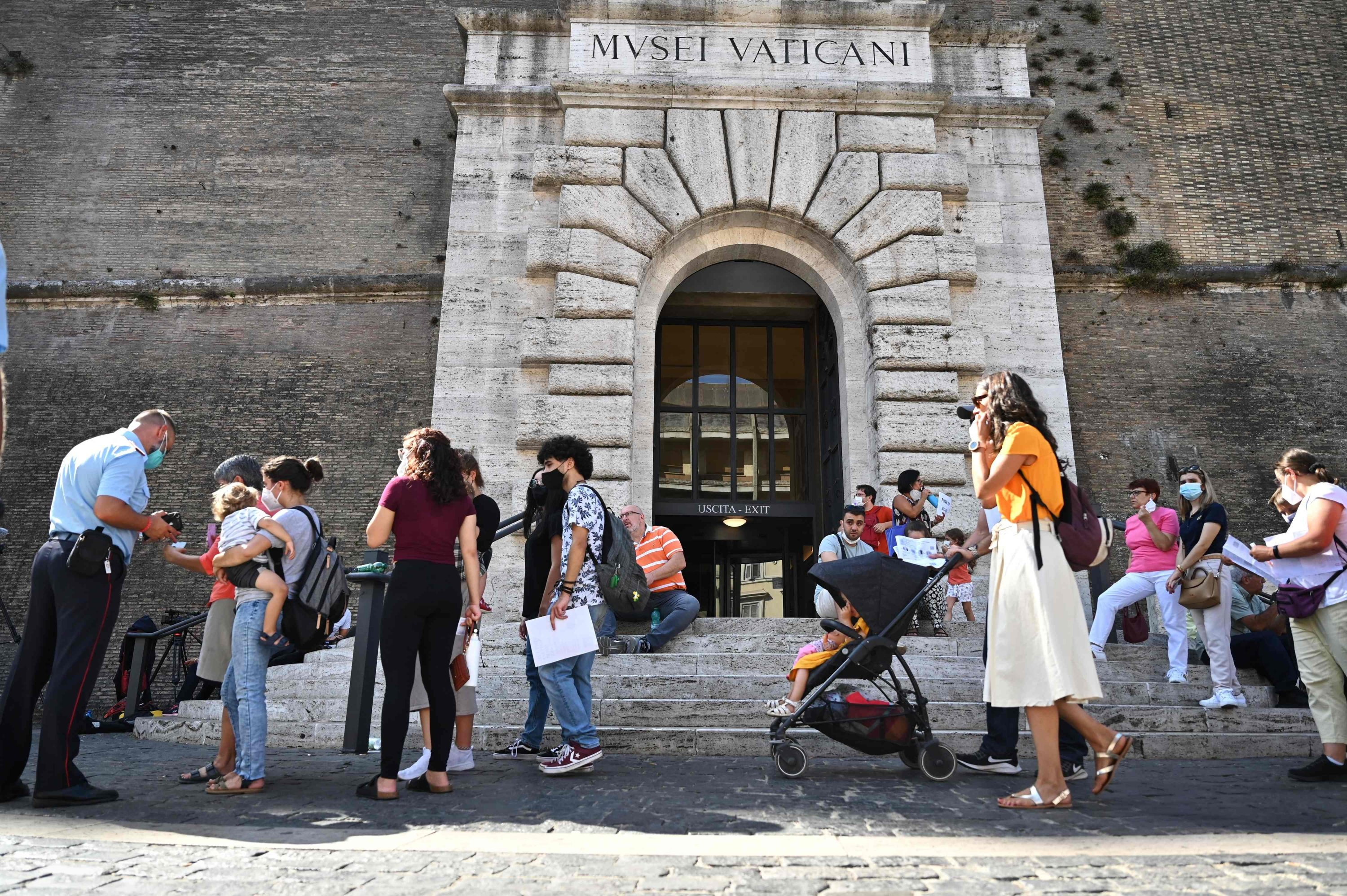 Visitors queue to show their COVID-19 certificates for scanning before entering the Vatican Museums in the Vatican, August 6, 2021. (AFP Photo)