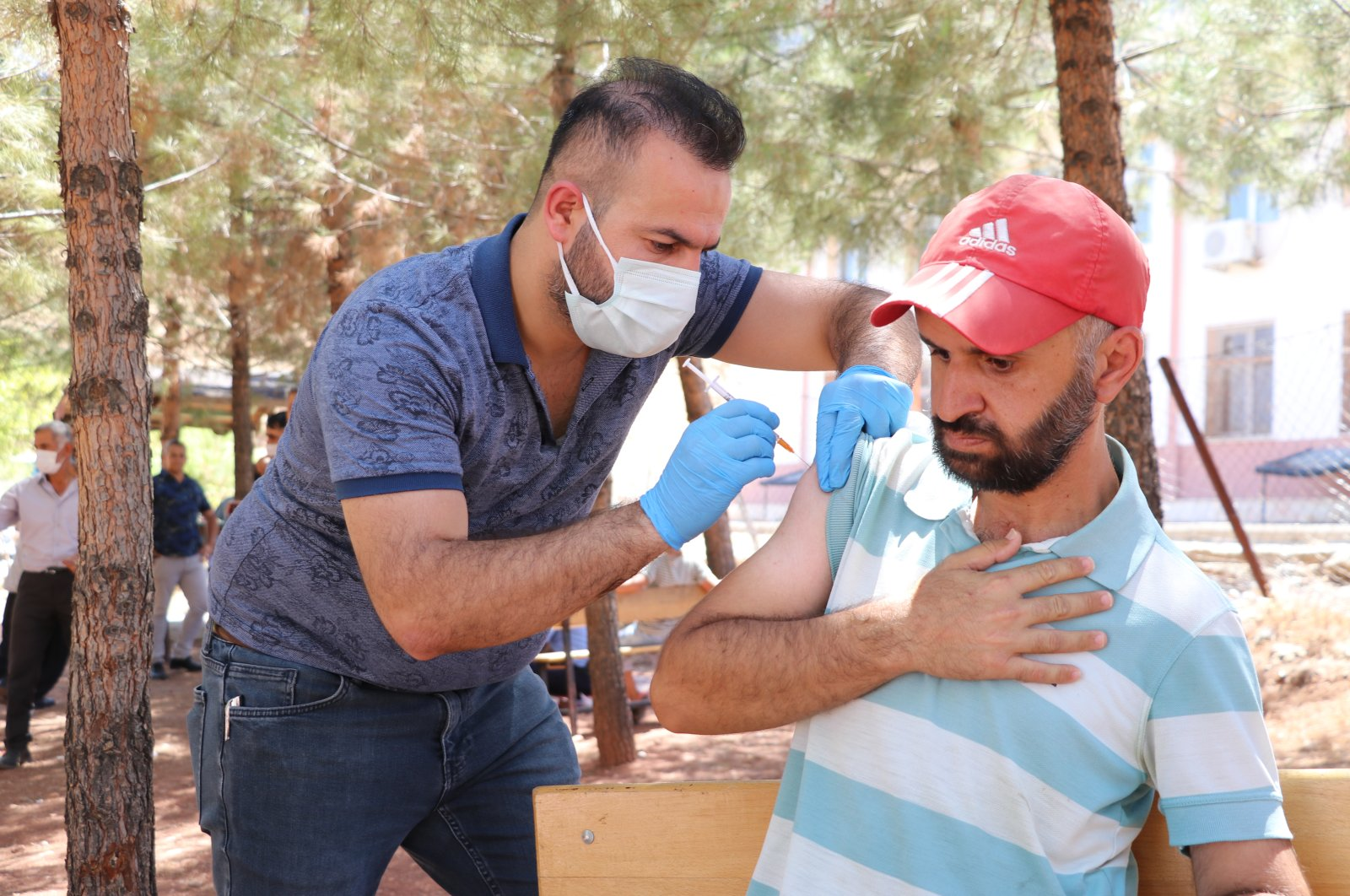 A man gets vaccinated in the courtyard of a school used as a vaccination venue, in Siirt, eastern Turkey, Aug. 5, 2021. (AA Photo)