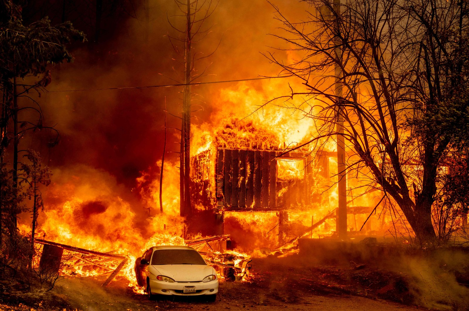 A home is engulfed in flames as the Dixie fire rages on in Greenville, California, U.S., Aug. 5, 2021. (AFP Photo)