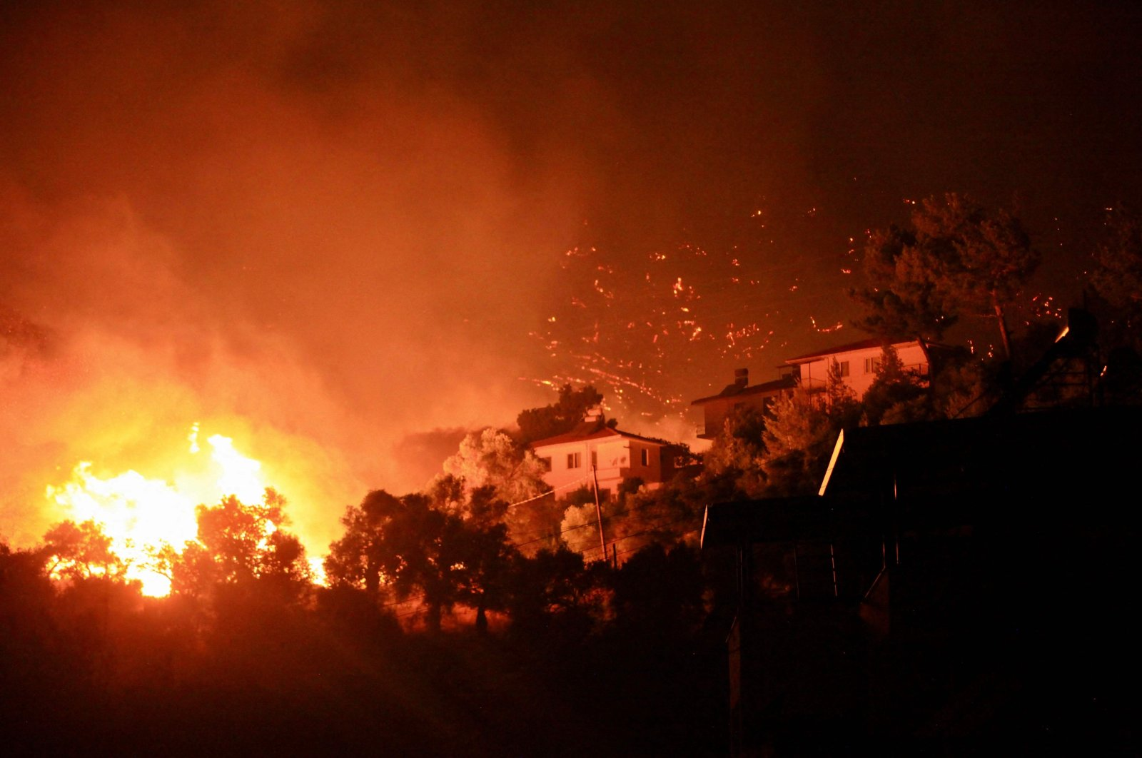 Flames rising from a fire spreading in the Aegean coast city of Ören, near Milas, in the holiday region of Muğla, Turkey, on Aug. 3, 2021. (AFP Photo)