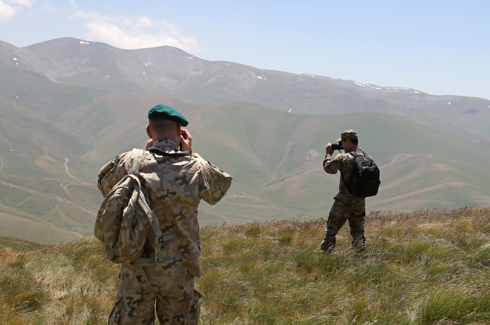 Foreign military attaches visit the line of contact on the Azerbaijani-Armenian border at the Sotk gold mine, Armenia, June 18, 2021 (Getty Images)
