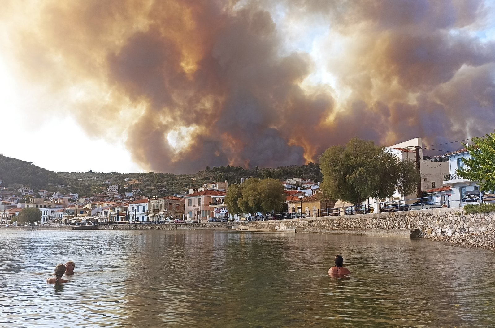 Flames burn on the mountain near Limni village on the island of Evia, about 160 kilometers (100 miles) north of Athens, Greece, Tuesday, Aug. 3, 2021. (AP Photo)