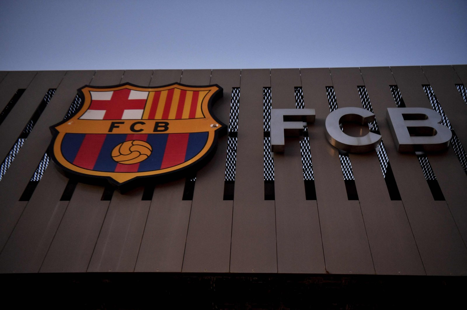 The logo of FC Barcelona on the facade of the Camp Nou stadium in Barcelona, Spain, Aug. 5, 2021. (AFP Photo)