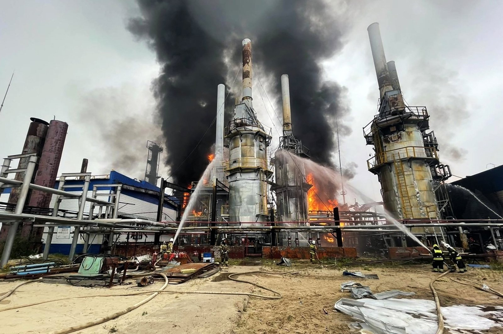 Firefighters spead water on a fire at a Gazprom gas condensate plant near the city of Novy Urengoy in Western Siberia, Russia, Aug. 6, 2021. (Photo by Russian Emergency Ministry via AFP)