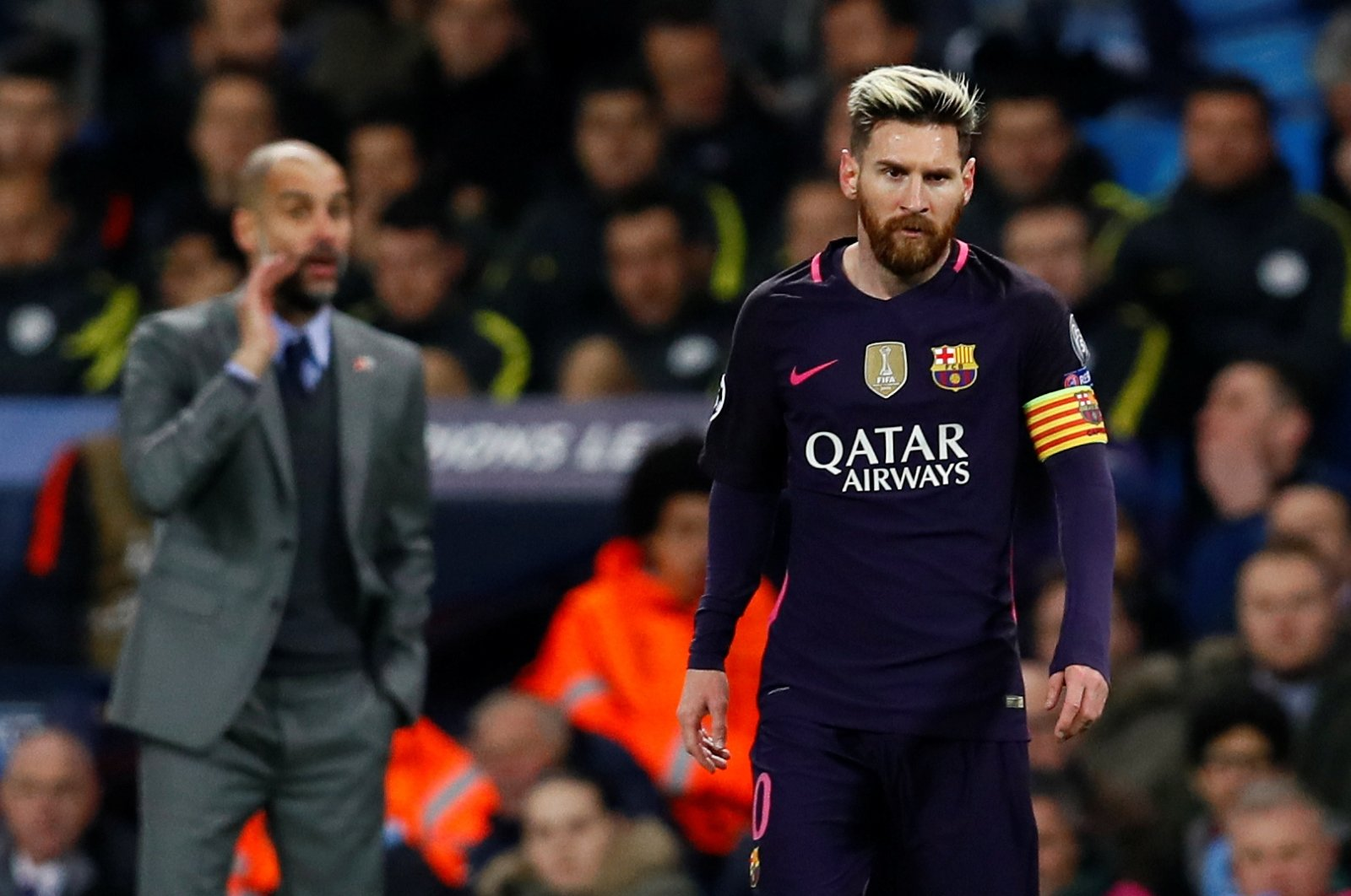 Manchester City manager Pep Guardiola and Barcelona's Lionel Messi during a UEFA Champions League Group C match at the Etihad Stadium, Manchester, England, Nov. 1, 2016 (Reuters Photo)