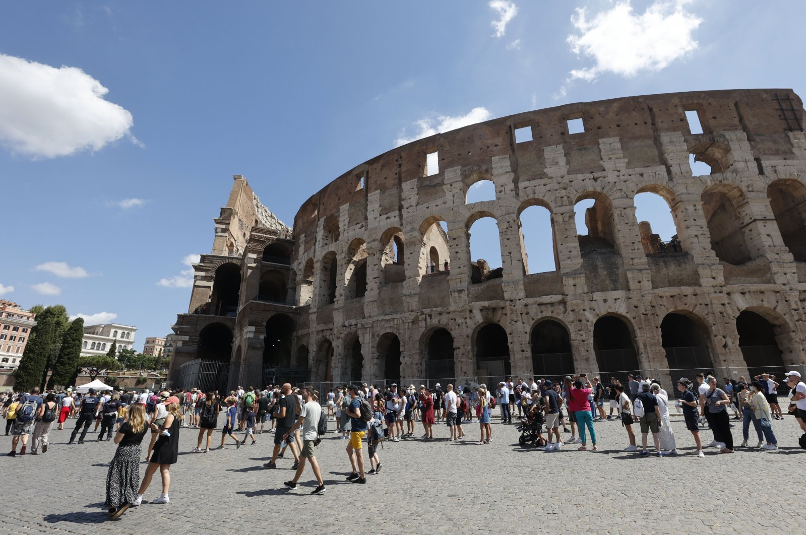 Tourists wait in a queue to enter the Colosseum in Rome, Italy, Aug. 6, 2021. (AP Photo)