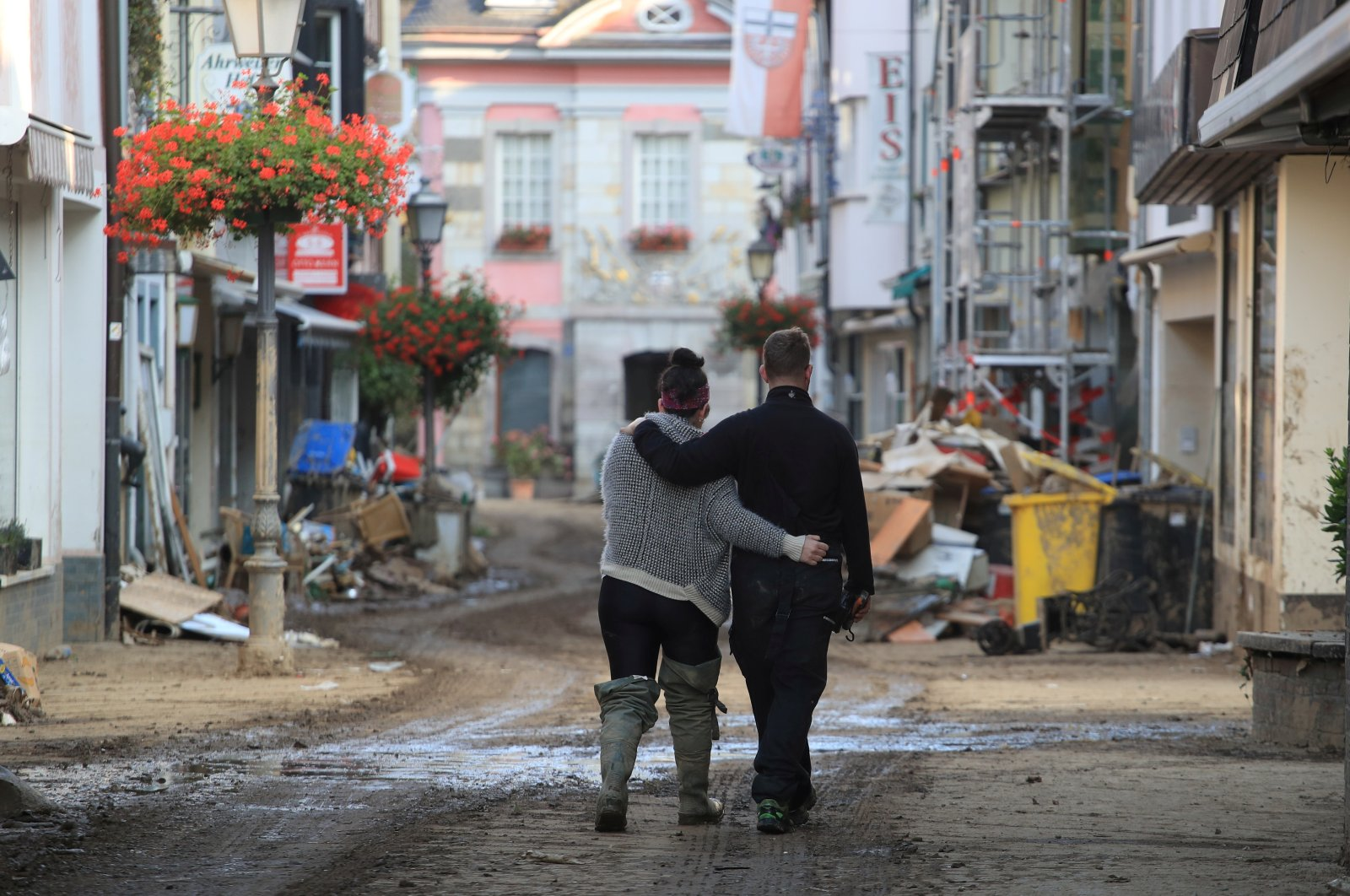 A couple walks on a street in Bad Neuenahr-Ahrweiler, along the Ahr river in Rhineland-Palatinate state, Germany, July 22, 2021. (Reuters Photo)