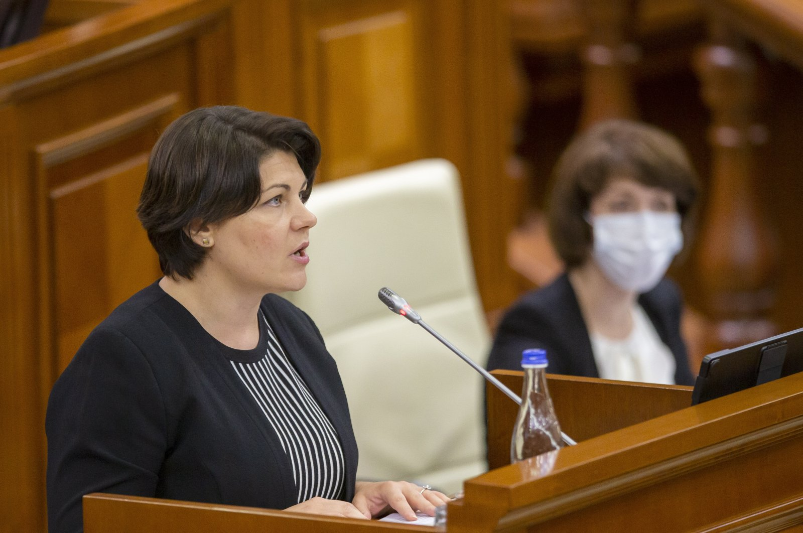 Prime minister-designate Natalia Gavrilita delivers her speech during a special session of Parliament to present her governmental program and a list of ministers, in Chisinau, Moldova, Aug. 6, 2021. (EPA Photo)