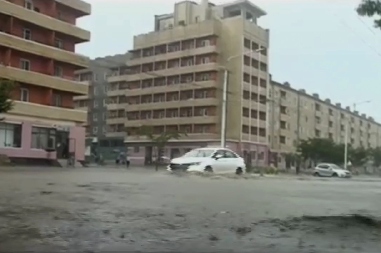 In this image taken from undated North Korean state broadcaster video, vehicles pass through flooded streets after heavy rains across South Hamgyong Province, North Korea. (AP Photo)