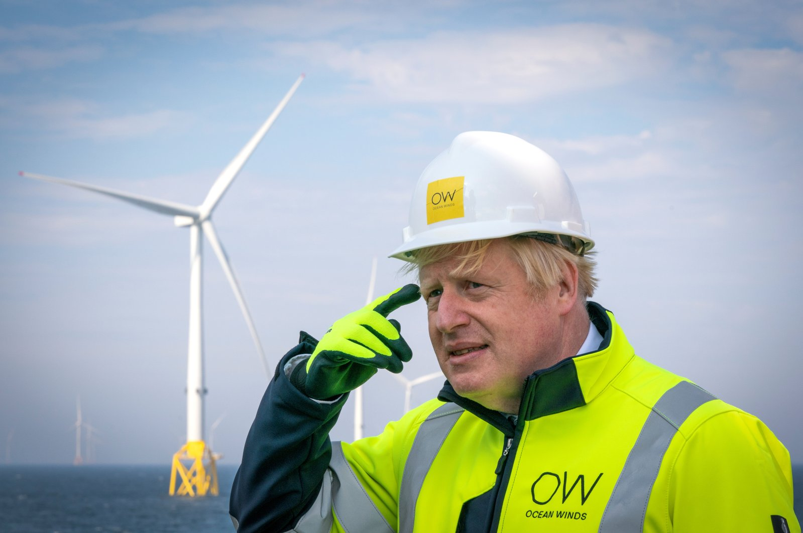 British Prime Minister Boris Johnson gestures onboard the Esvagt Alba during a visit to the Moray Offshore Windfarm East, off the Scottish Aberdeenshire coast, Aug. 5, 2021. (Reuters Photo)