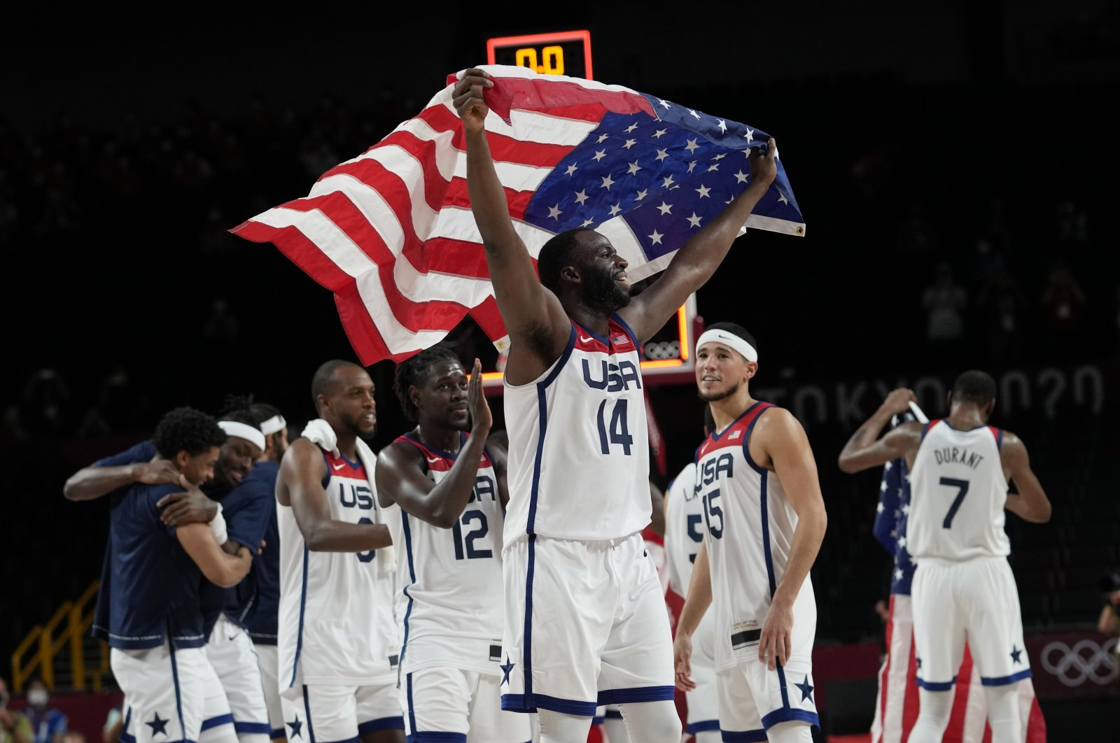 United States' players celebrate after their win in the men's basketball gold medal game against France at the 2020 Summer Olympics in Saitama, Japan, Aug. 7, 2021. (AP Photo)