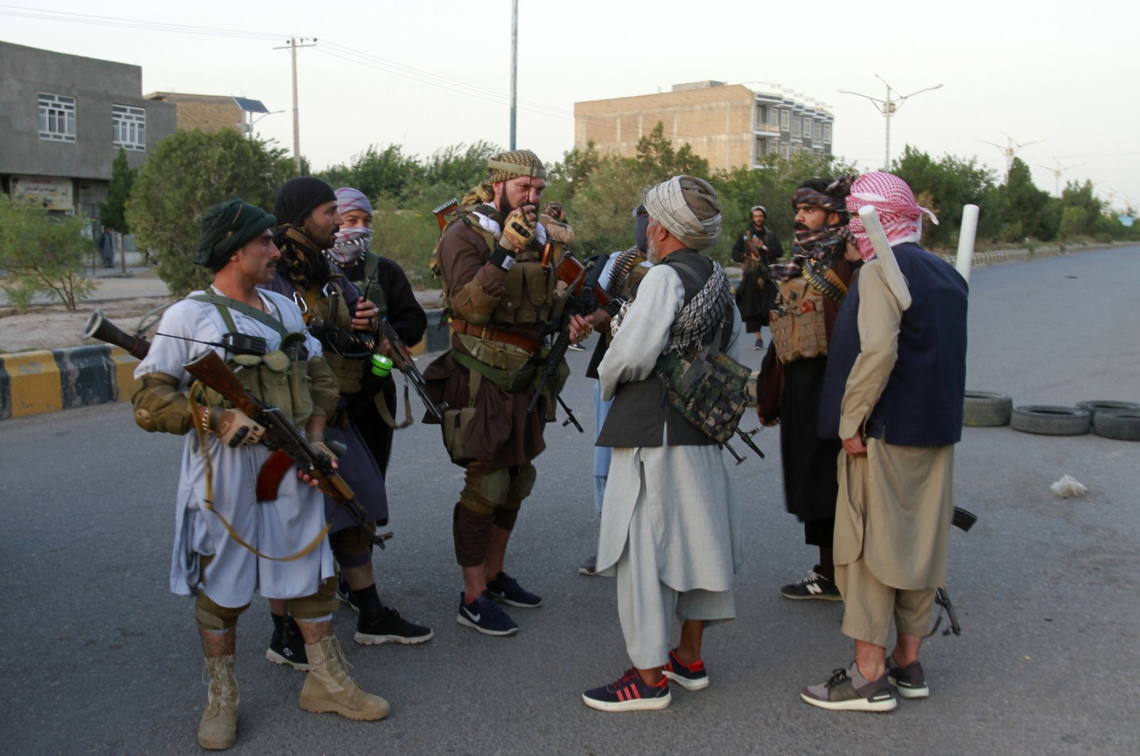 Private militia loyal to Ismail Khan, the former Mujahideen commander, talks with each others and patrols after security forces took back control of parts of Herat city following fighting between Taliban and Afghan security forces in Herat province, west of Kabul, Afghanistan, Aug. 6, 2021. (AP Photo)