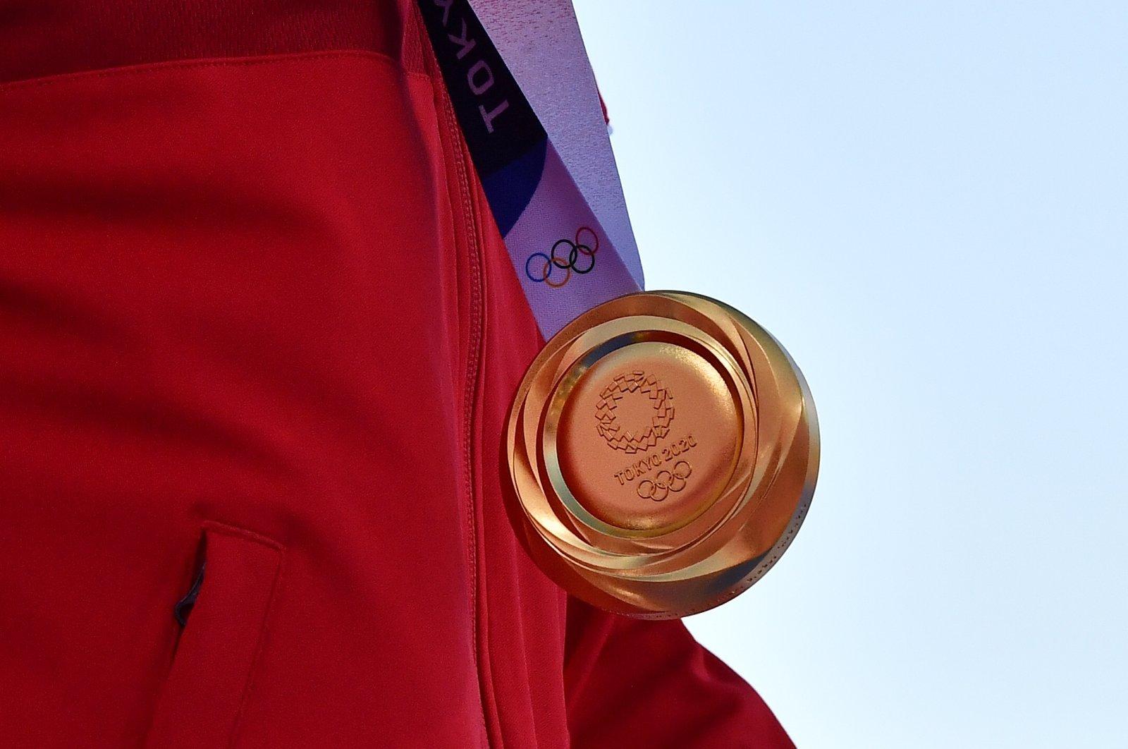 Archer Mete Gazoz of Turkey wears his gold medal at the Yumenoshima Archery Field in Tokyo, Japan, July 31, 2021. (Reuters Photo)