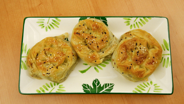 Classic Turkish gül börek with sesame and nigella seeds. (Shutterstock Photo)