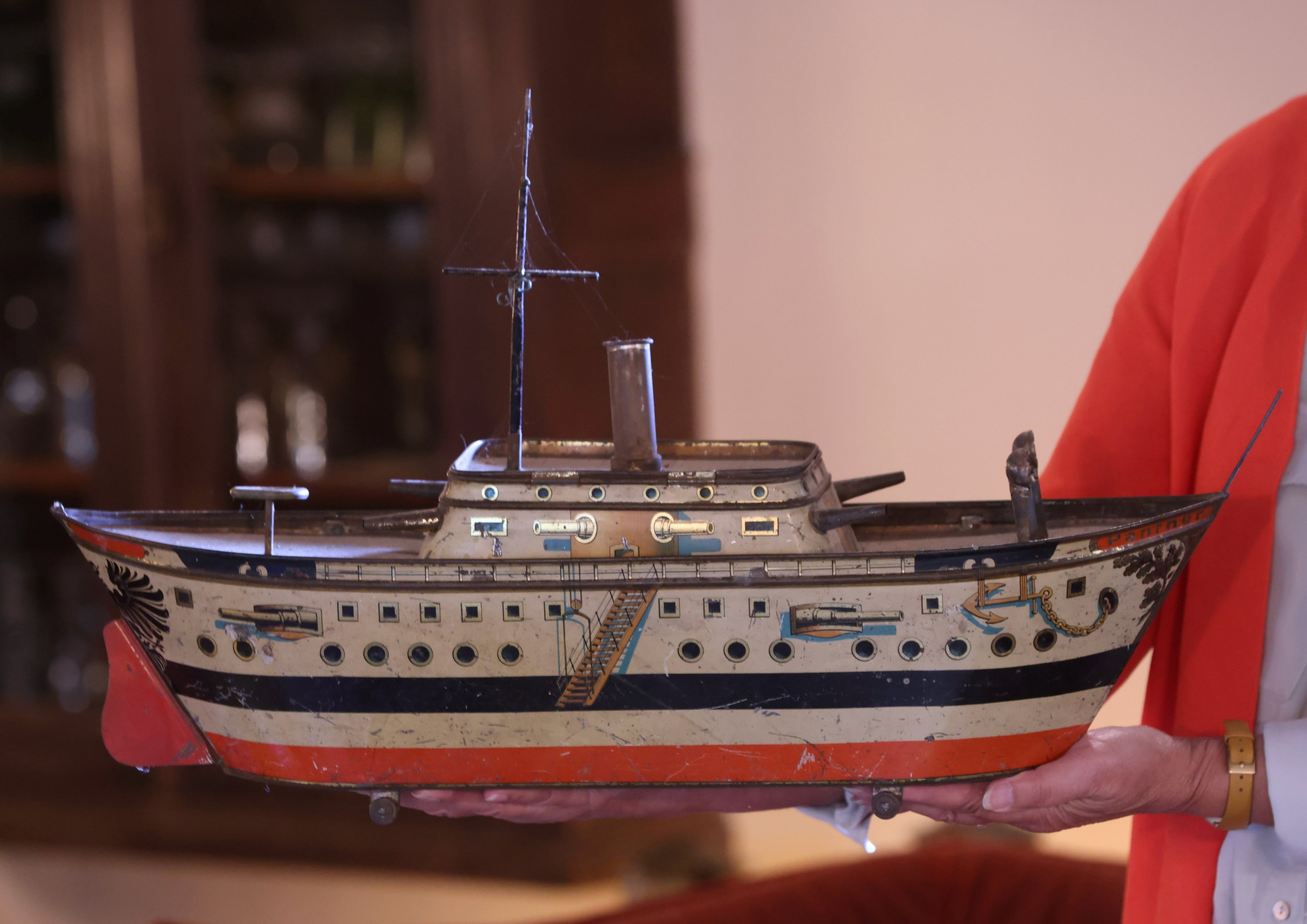 A metal vintage lithographed tin box in shape of a boat, part of a huge collection of almost 60,000 pieces started 30 years ago by Yvette Dardenne, 83, is displayed at her house in Grand-Hallet, Belgium, Aug. 5, 2021. (Reuters Photo)