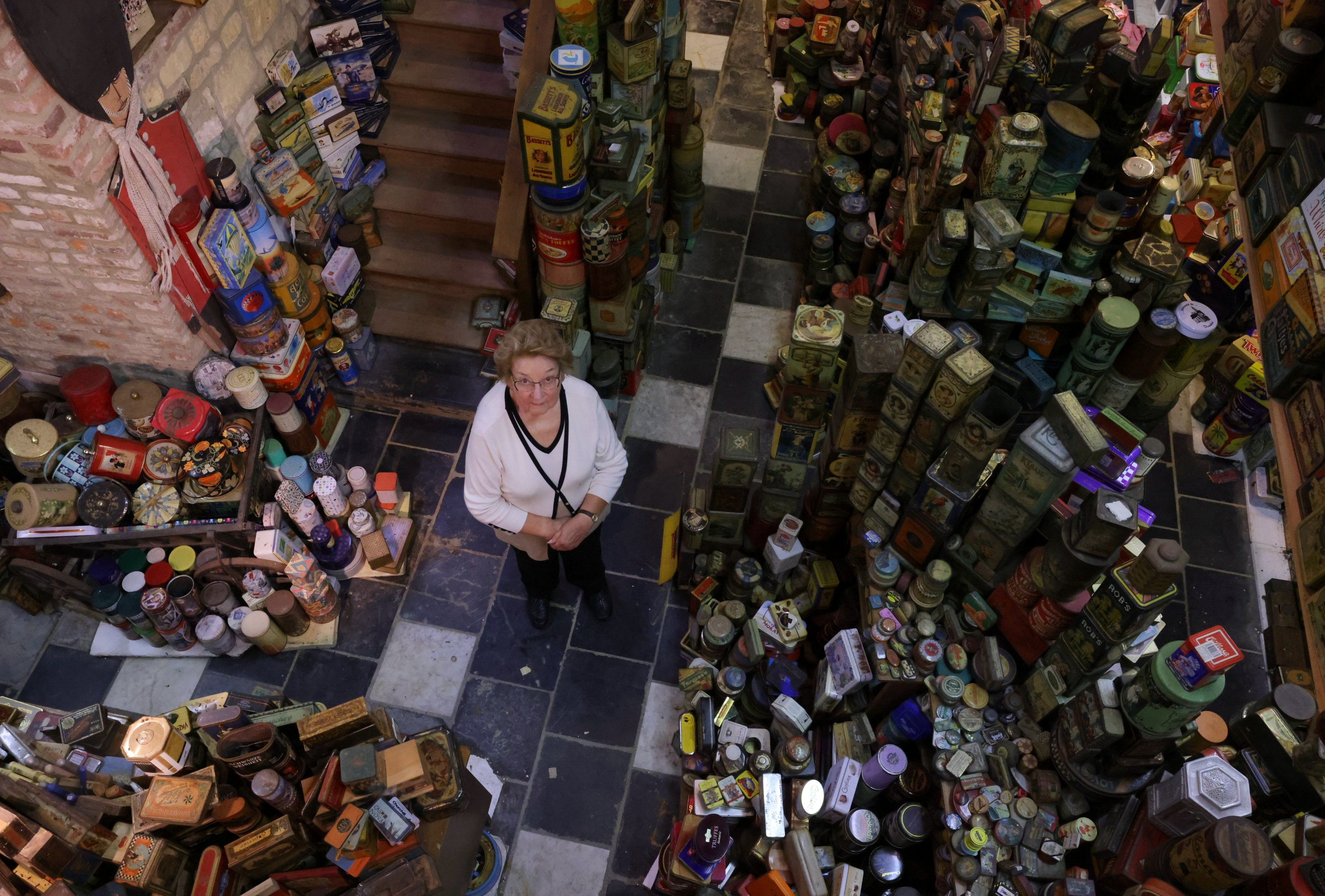 Yvette Dardenne, stands among thousands of vintage lithographed tin boxes, which are part of a huge collection of almost 60,000 pieces started 30 years ago, at her house in Grand-Hallet, Belgium, Aug. 5, 2021. (Reuters Photo)
