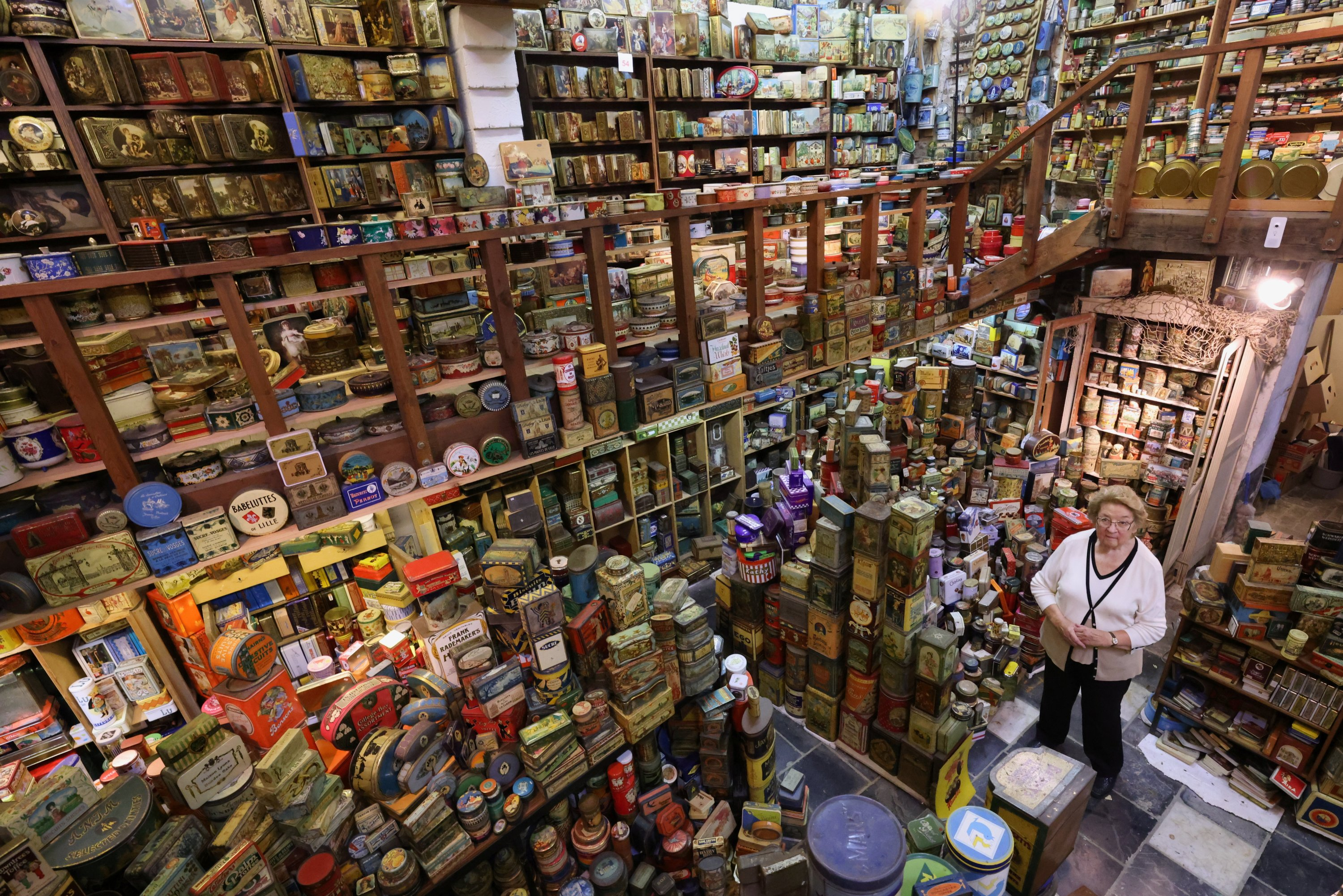 Yvette Dardenne, 83, stands among thousands of vintage lithographed tin boxes, which are part of a huge collection of almost 60,000 pieces started 30 years ago, at her house in Grand-Hallet, Belgium, Aug. 5, 2021. (Reuters Photo)