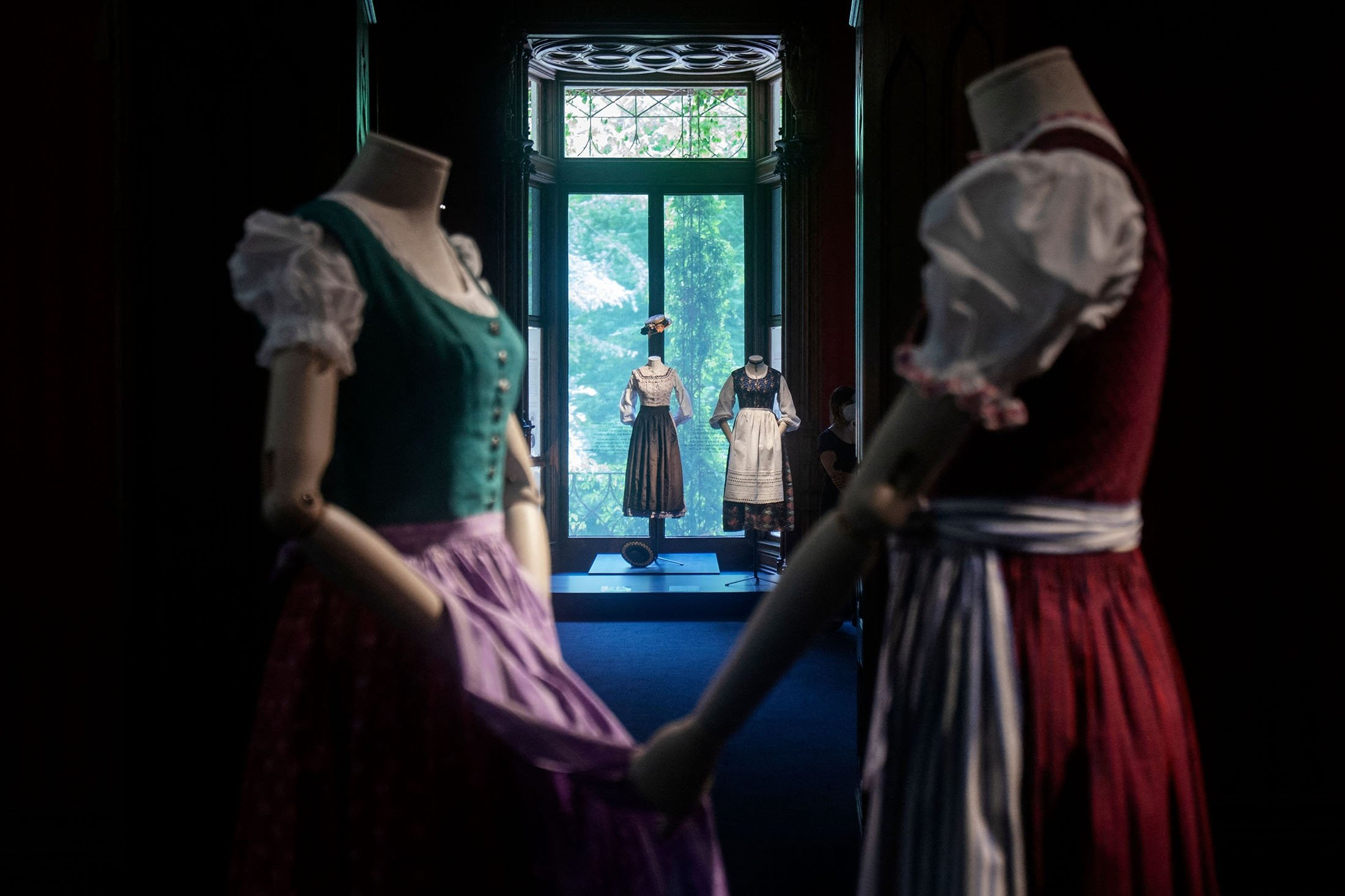 Dirndl dresses are on display at the exhibition 'Dirndl – Tradition goes fashion' at the Mamorschloessl palace in Bad Ischl, Upper Austria, June 24, 2021. (AFP Photo)