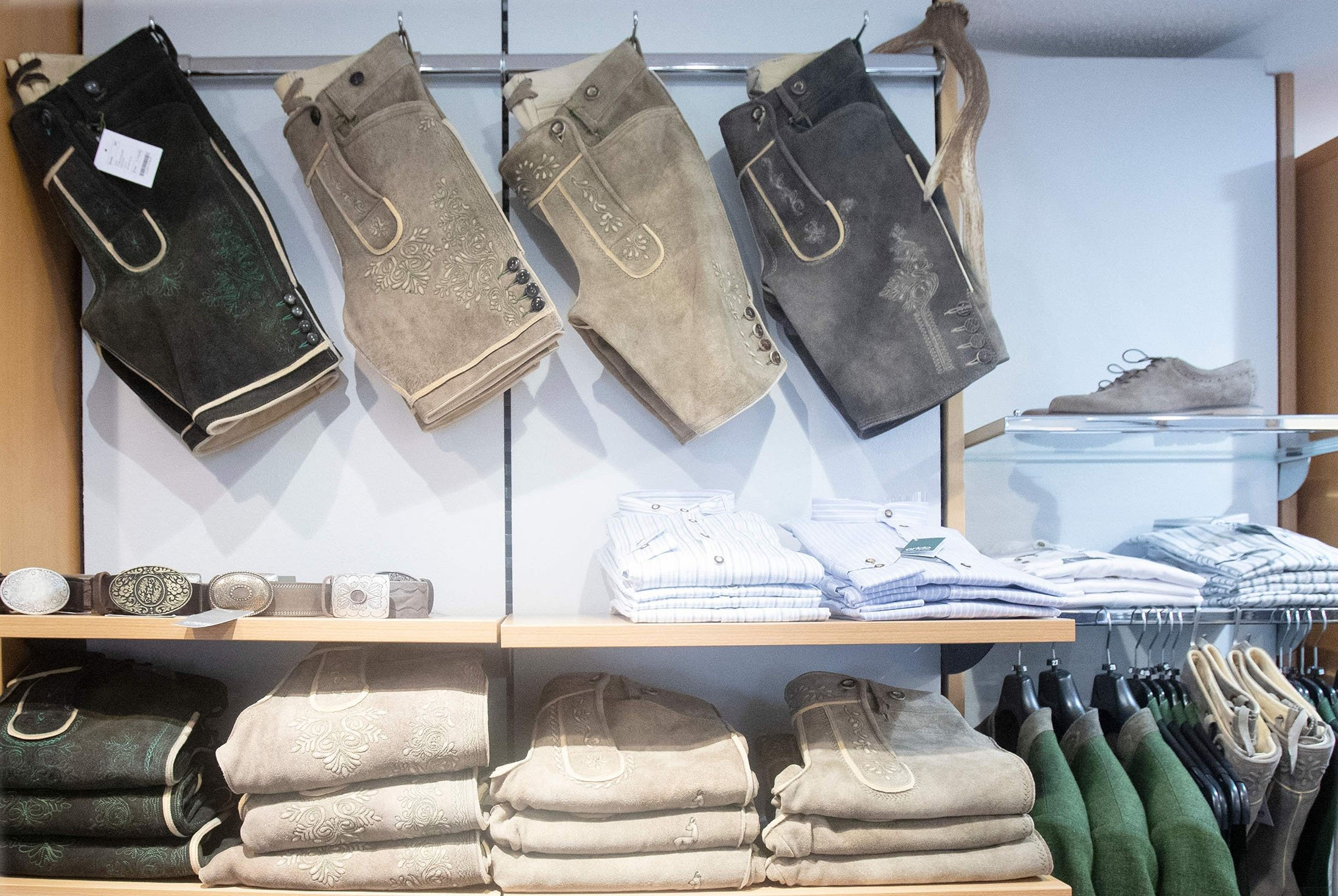Short lederhosen leather trousers and traditional costumes are on display at the Schauer Atelier dirndl shop in Bad Ischl, Upper Austria, June 24, 2021. (AFP Photo)