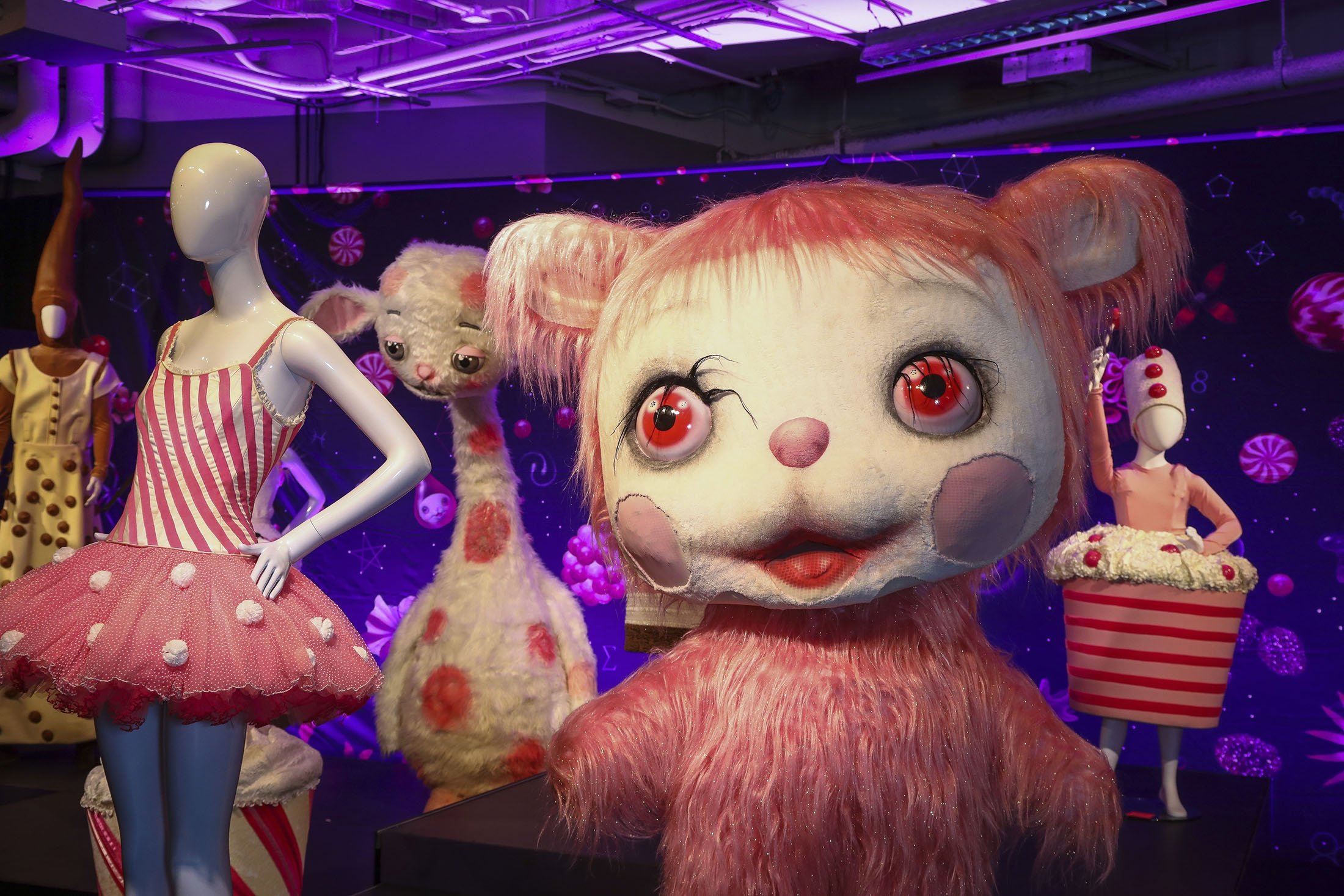 Costumes from the American Ballet Theatre production of 'Whipped Cream' are displayed at the 'Showstoppers! Spectacular Costumes from Stage & Screen' exhibit in Times Square, New York, U.S., Aug. 2, 2021. (AP Photo)