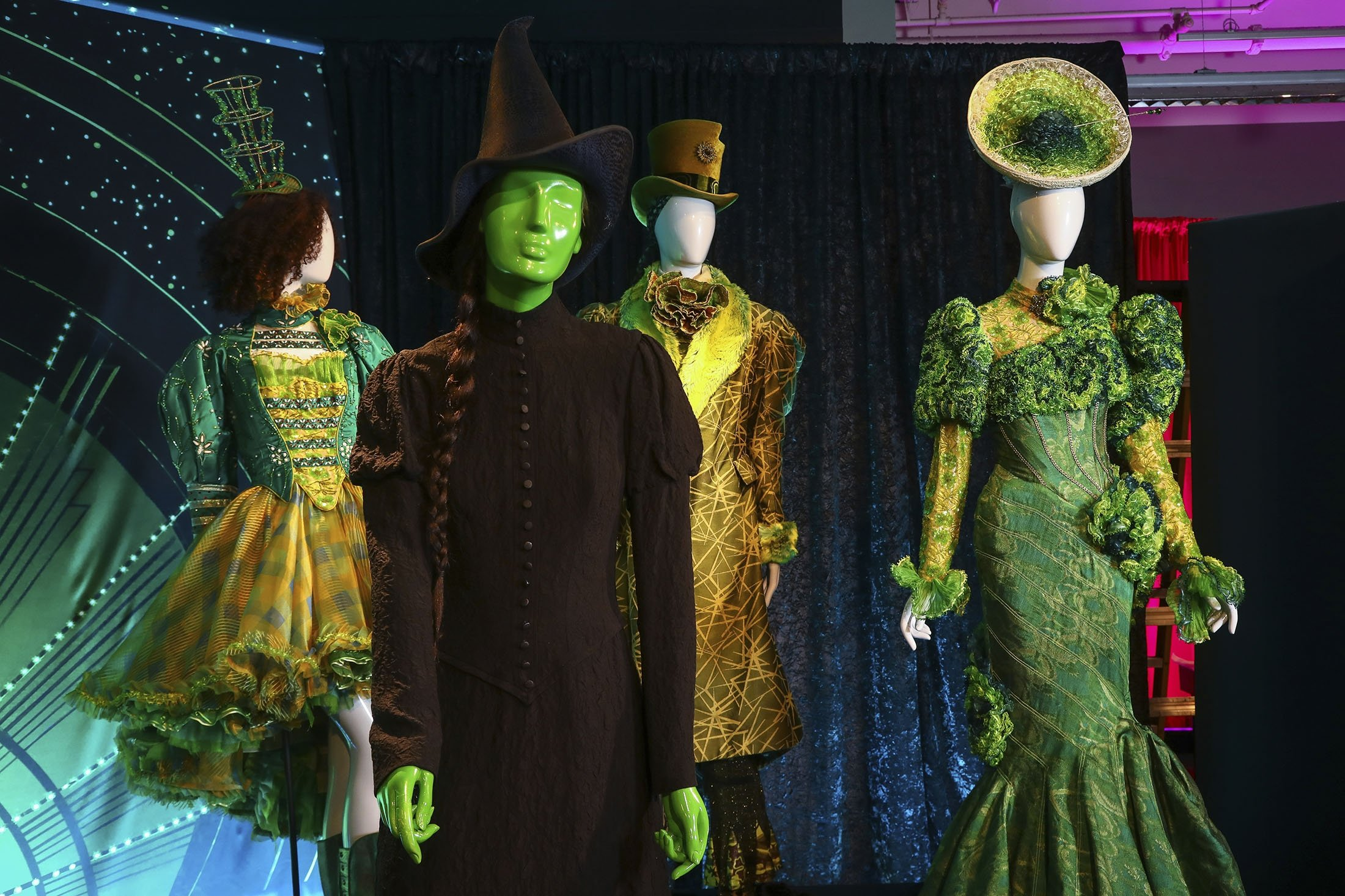 Costumes from the Broadway musical 'Wicked' are displayed at the 'Showstoppers! Spectacular Costumes from Stage & Screen' exhibit in Times Square, New York, U.S., Aug. 2, 2021. (AP Photo)
