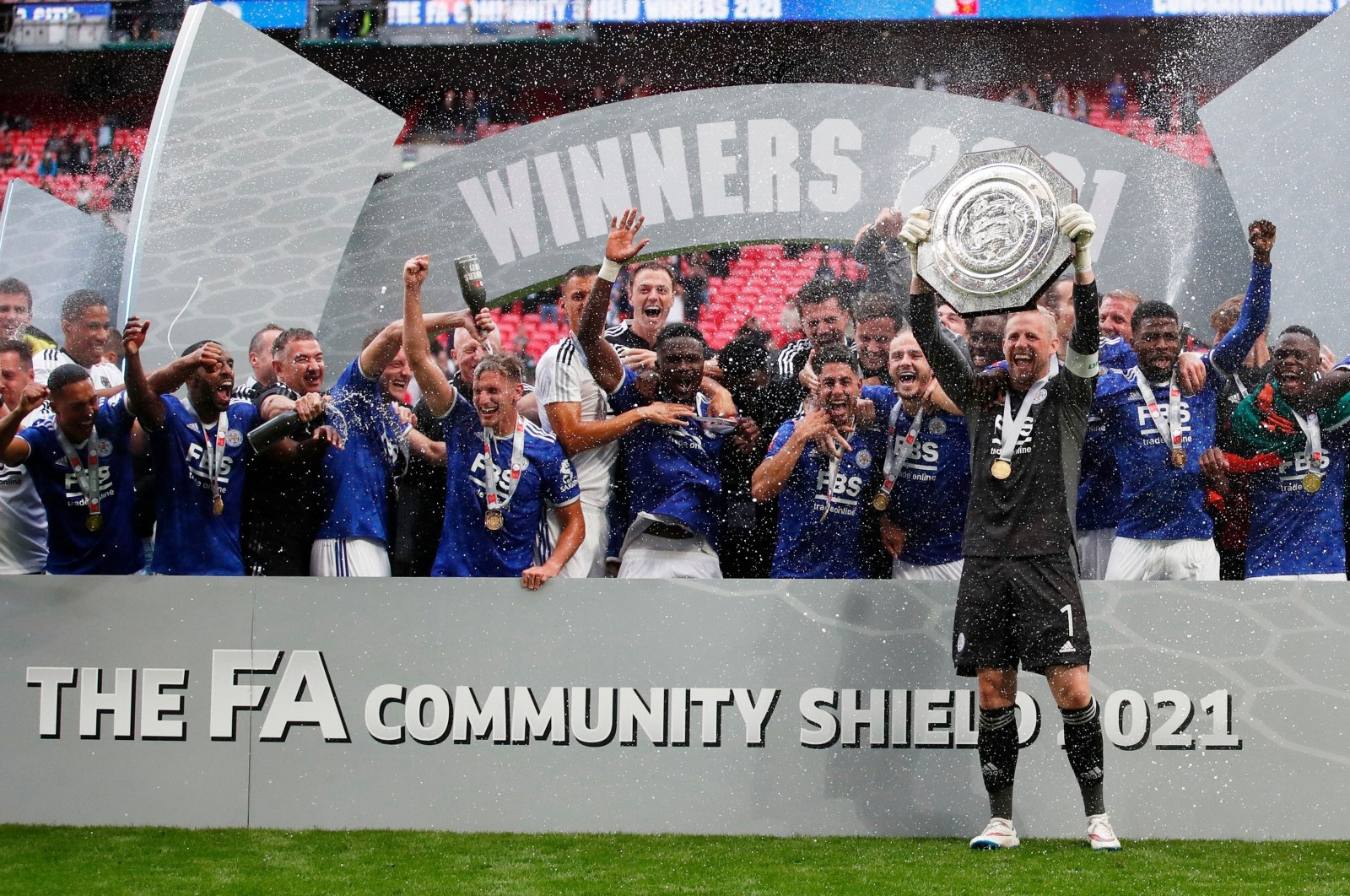 Leicester City's Kasper Schmeichel and teammates celebrate with the FA Community Shield trophy after beating Manchester City at theWembley Stadium, London, England,Aug. 7, 2021.