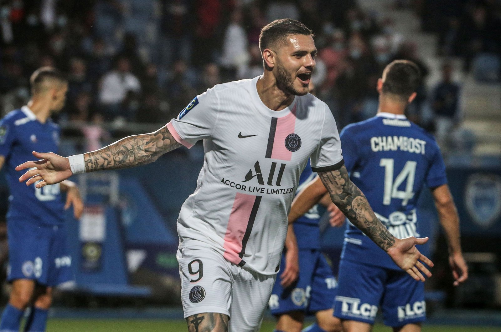 Paris Saint-Germain's Argentinian forward Mauro Icardi celebrates after scoring a goal during the French Ligue 1 match against Troyes at the Stade de l'Aube in Troyes, France, Aug. 7, 2021. (AFP Photo)