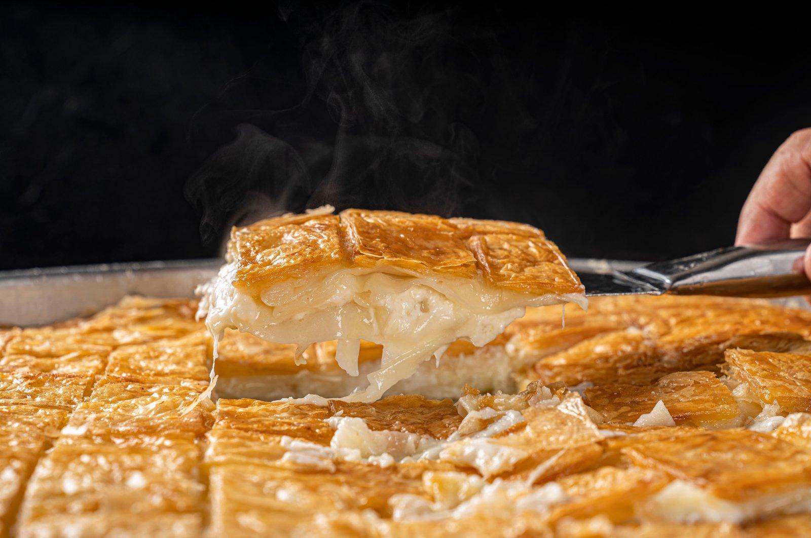 A tray of cheese-filled su börek. (Shutterstock Photo)
