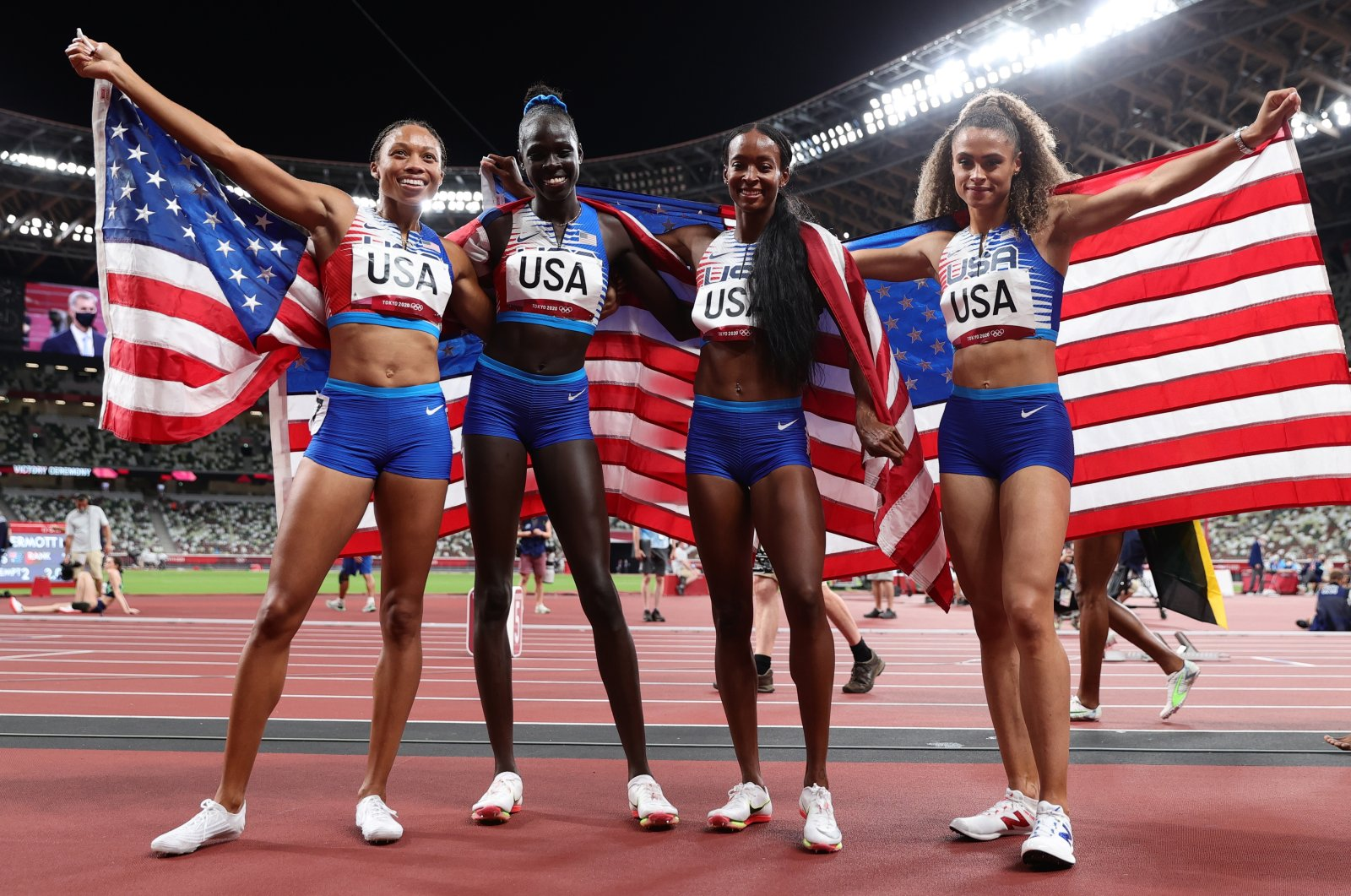 Team USA's Sydney McLaughlin, Allyson Felix, Dalilah Muhammad and Athing Mu celebrate winning women's 4 x 400m relay gold at the Tokyo 2020 Olympic Games at the Olympic Stadium, Tokyo, Japan, Aug. 7, 2021. (EPA Photo)