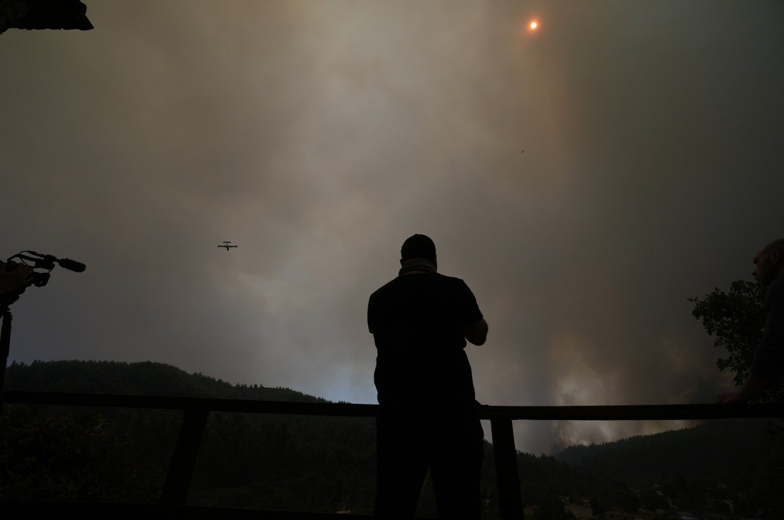 An aircraft operates over a wildfire in Gouves village on the island of Evia, about 185 kilometers (115 miles) north of Athens, Greece, Sunday, Aug. 8, 2021. (AP Photo)