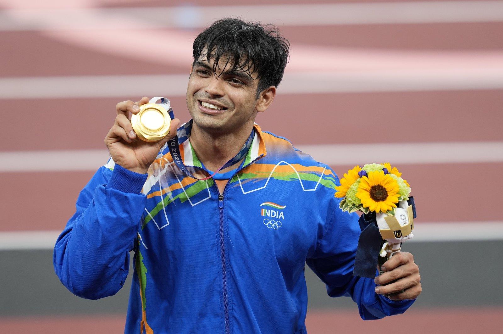 India's Neeraj Chopra celebrates winning gold in the men's javelin throw final during the Tokyo 2020 Olympic Games, Tokyo, Japan, Aug. 7, 2021. (EPA Photo)