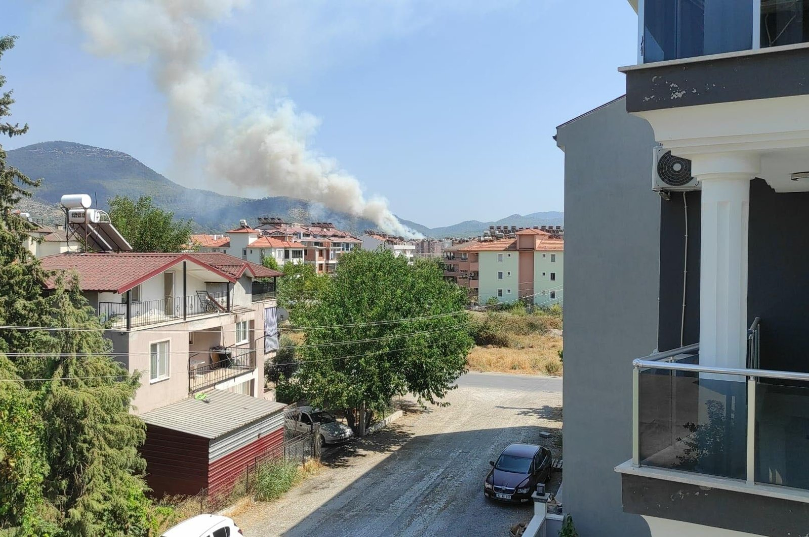 Smoke billows from a forest fire in Muğla's Dalaman on Aug. 8, 2021 (DHA Photo)